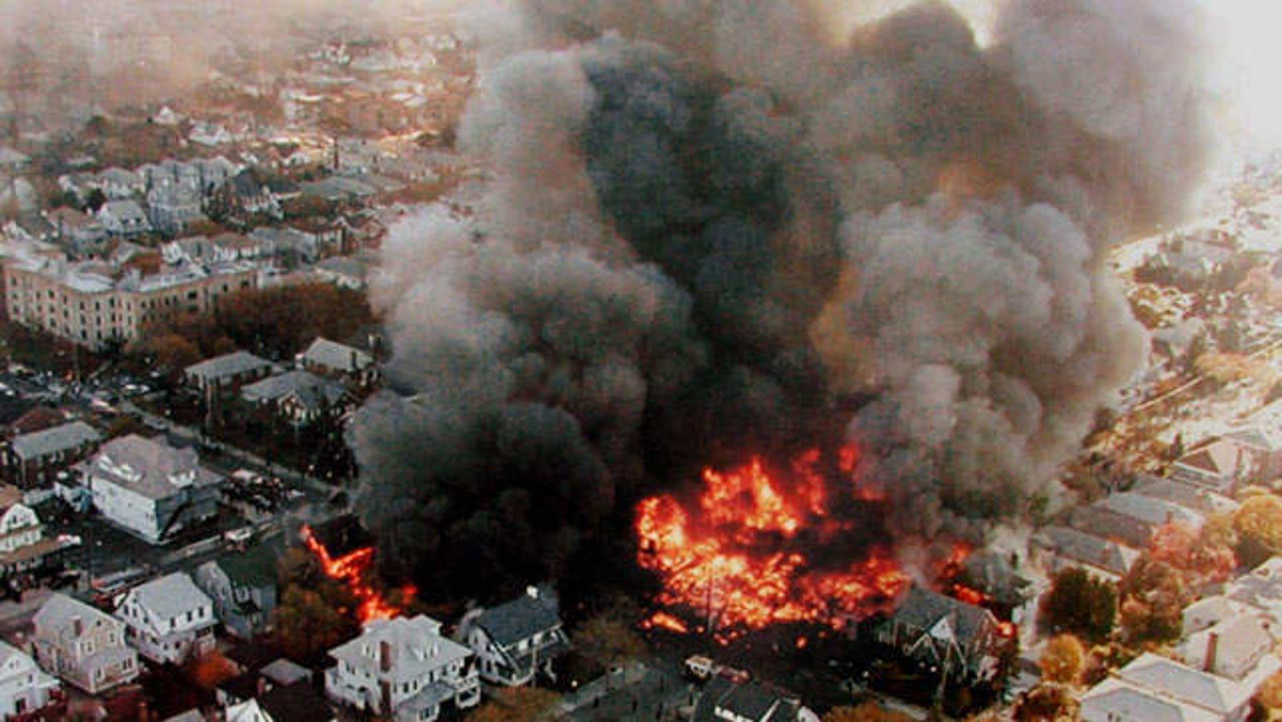 Nov. 12, 2001: Fires burning in New York's Belle Harbor neighborhood, from the crash of American Airlines Flight 587 which killed 265 people.