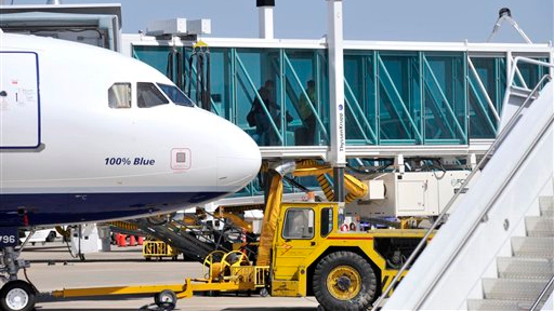 March 27, 2012: Passengers depart from JetBlue flight 191 at Amarillo Rick Husband International Airport in Amarillo, Texas after an unruly pilot caused the flight to make an emergency landing.