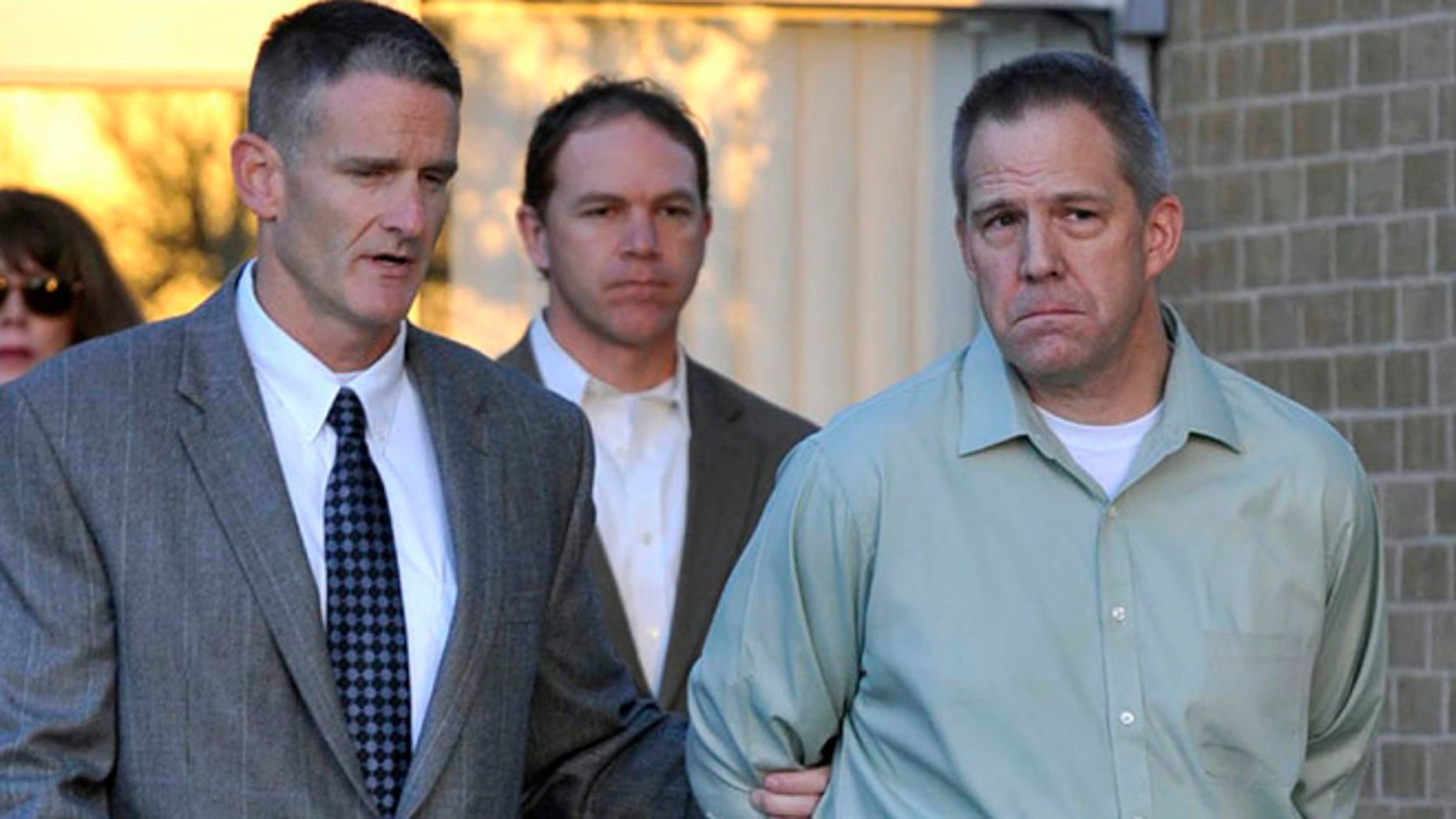 April 2, 2012: In this file photo, JetBlue pilot Clayton Frederick Osbon, right, is escorted to a waiting vehicle by FBI agents in Amarillo, Texas.