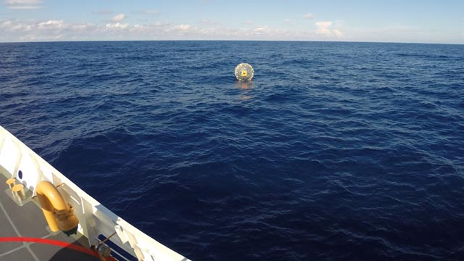 October 4, 2014: In this photo provided by the U.S. Coast Guard, the Coast Guard arrives on scene off the coast of Miami to respond to a report of a man aboard an inflatable hydro bubble who was disoriented. (AP Photo/U.S. Coast Guard)
