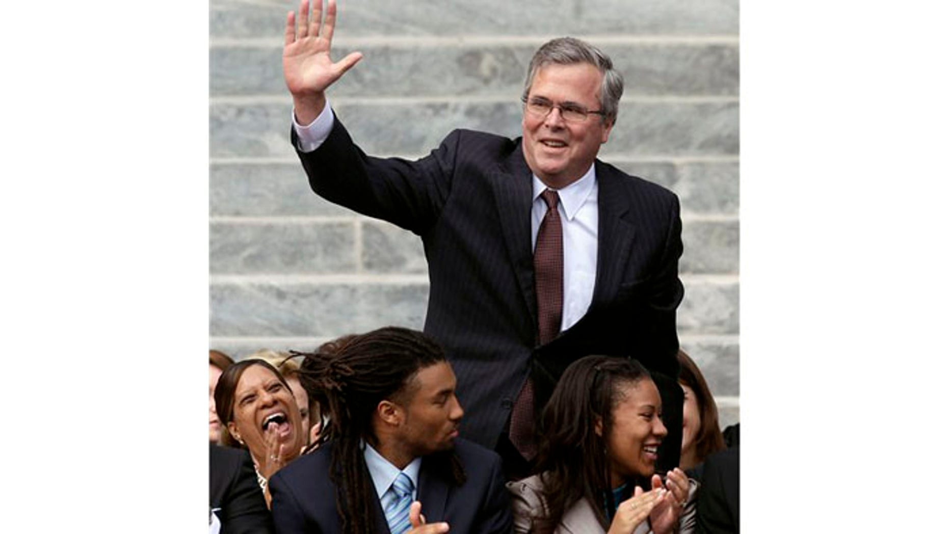 January 2011: Former Florida Gov. Jeb Bush waves as he is introduced to the crowd during inauguration ceremonies for Republican Gov. Rick Scott outside the Old Capitol in Tallahassee, FL.