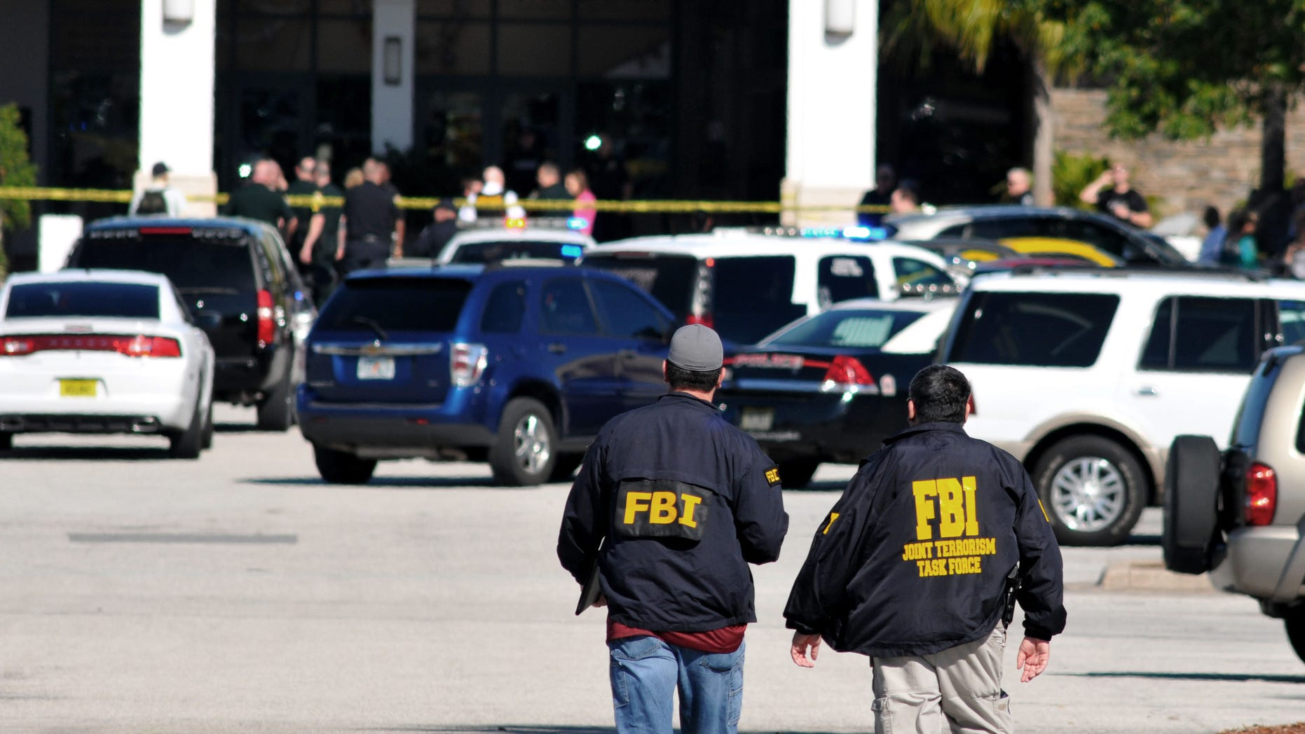 """Law enforcement including the FBI respond to the scene of a shooting at the Melbourne Square Mall on Saturday, Jan 17, 2015 in Melbourne, Fla. Melbourne Police have confirmed that the shooting Saturday morning at the mall has left two people dead and one injured from a gunshot wound. Police say the injured victim is hospitalized in stable condition and cooperating with investigators. After responding to reports around 9:30 a.m. of multiple shots fired inside the mall, police tweeted that the """"shooter is contained."""" (AP Photo/Florida Today, Malcolm Denemark)  NO SALES"""