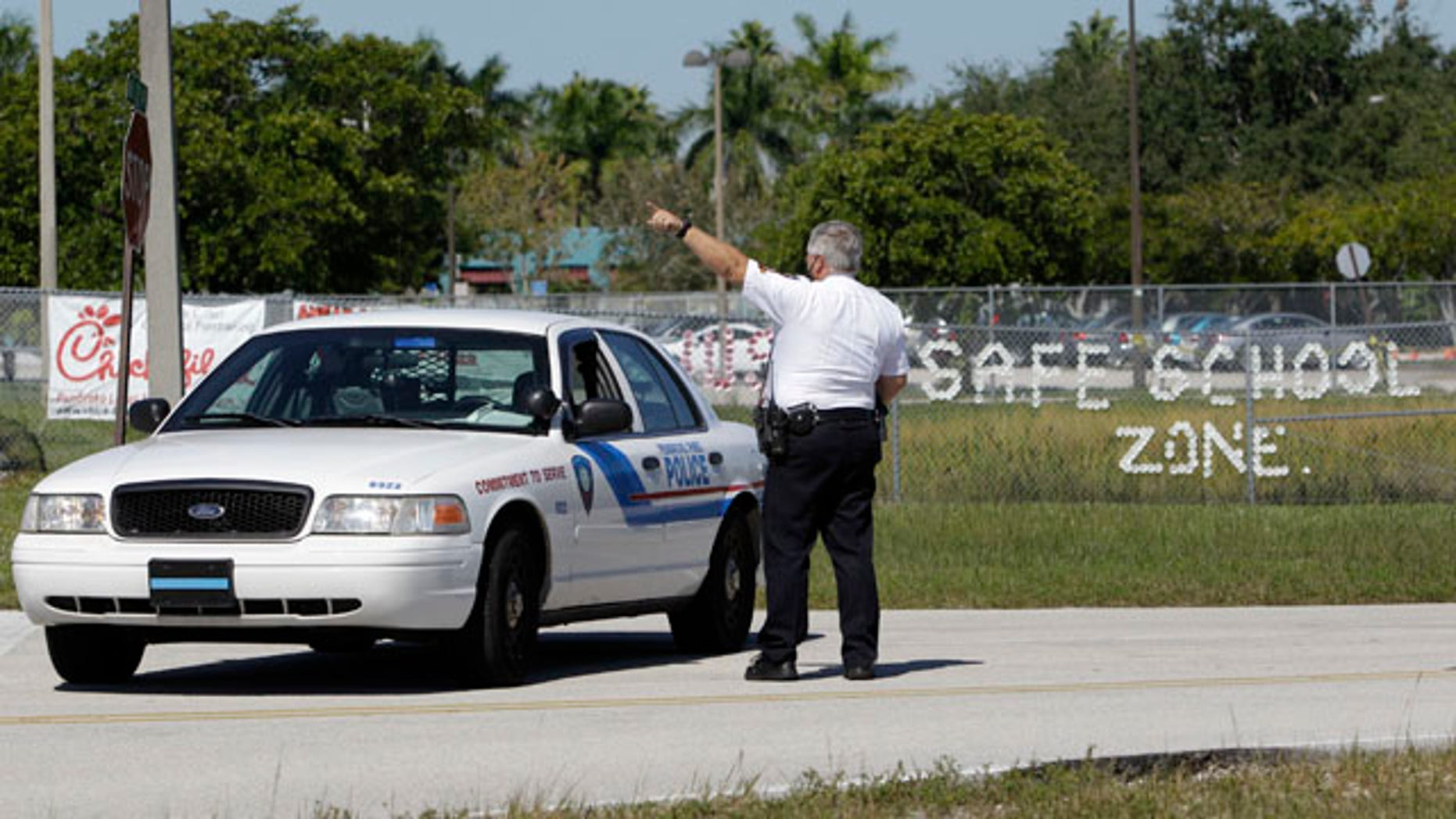 Nov. 10: Pembroke Pines police officer Michael Banks directs traffic away from Walter C. Young Middle School in Pembroke Pines, Fla. Schools in Broward County were on lockdown after authorities said an unidentified woman called a radio station, saying her husband might go to a school and start shooting.
