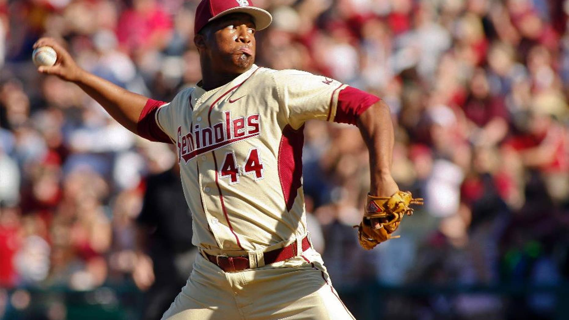 FILE - In this March 2, 2014, file photo, Florida State relief pitcher Jameis Winston throws in the ninth inning of an NCAA collegebaseballgame against Miami in Tallahassee, Fla. Winston put together the best pitching outing of his collegiate baseball career in the Seminoles' 13-inning win against North Carolina State on Saturday, March 15, 2014. (AP Photo/Phil Sears, File)
