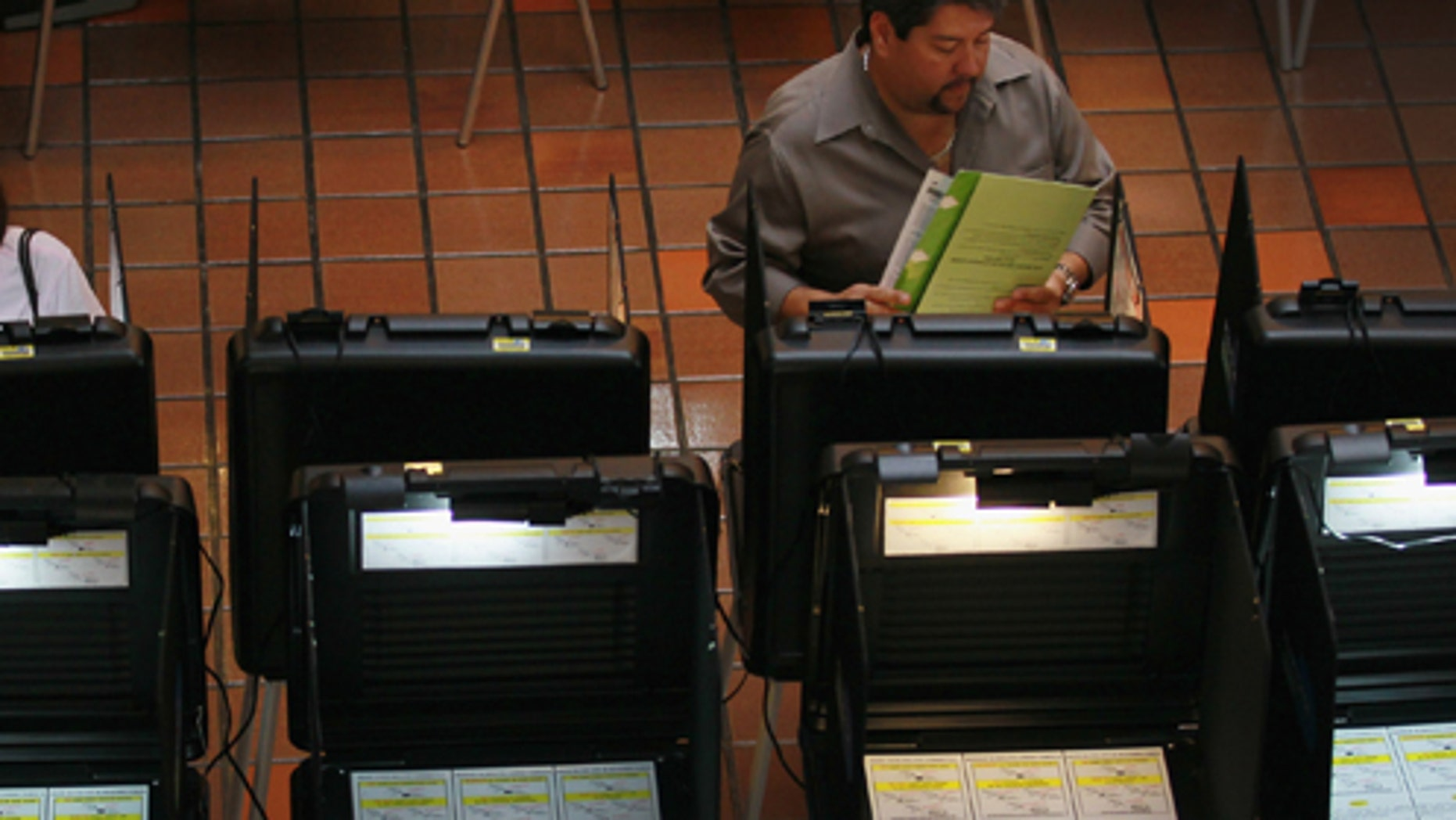 MIAMI, FL - MAY 09: Early voters fill out their ballots as they cast their votes before the general election date scheduled for May 24th, during the special election to select a new Miami-Dade mayor on May 9, 2011 in Miami, Florida. The former mayor Carlos Alvarez was voted out of office by voters unhappy with a property tax rate increase and the fact that he gave salary raises to county employees during a deep recession. The vote to oust the former mayor made Miami-Dade the most populous area ever to recall a local official. 11 candidates are running for the open seat.  (Photo by Joe Raedle/Getty Images)