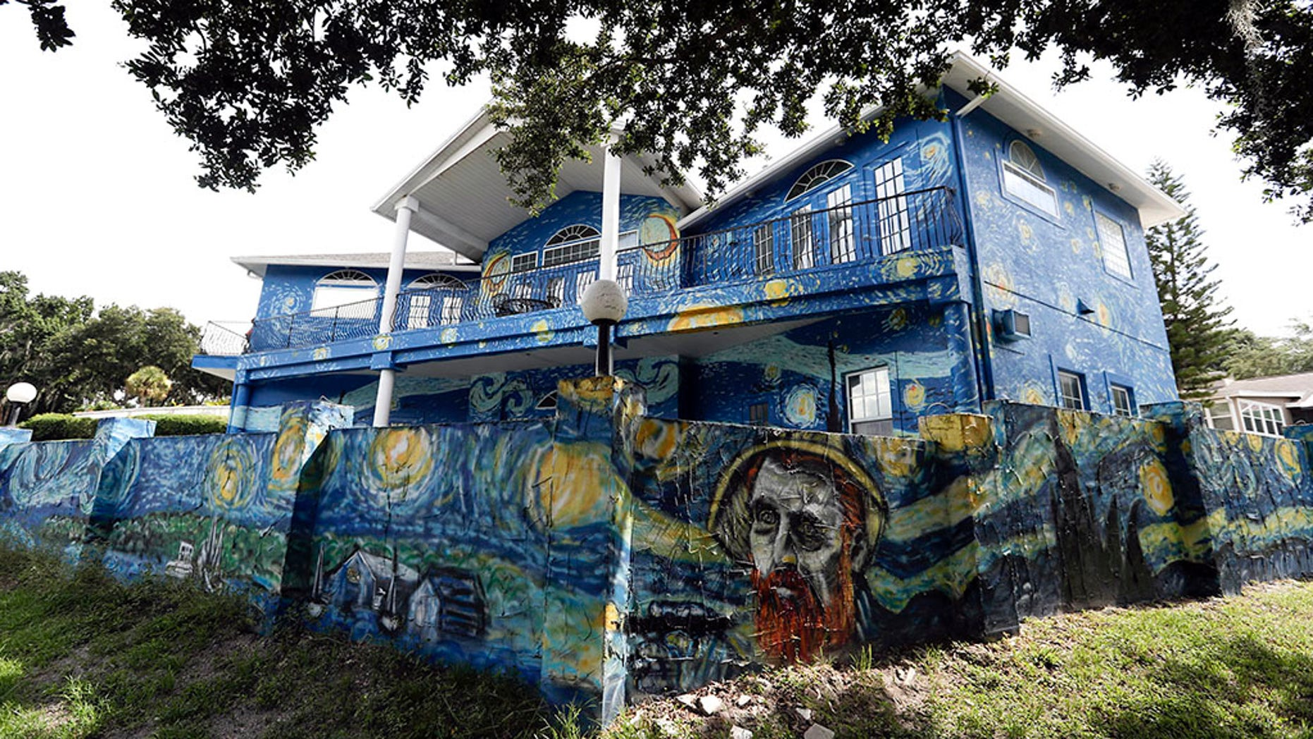 This Wednesday, July 18, 2018 photo shows the painted exterior of the home of Lubomir Jastrzebski and Nancy Nemhauseer in Mount Dora, Fla.