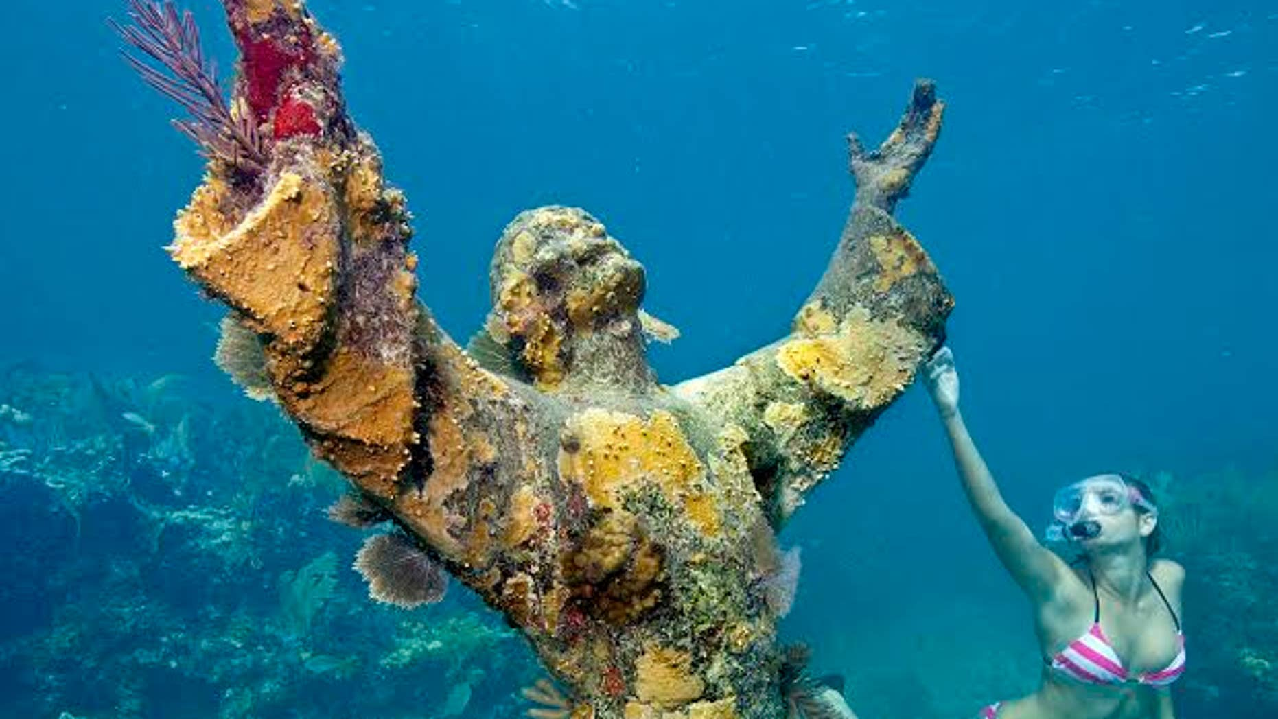 "Katherine Wieland snorkels by the ""Christ of the Abyss"" statue, an underwater icon for John Pennekamp Coral Reef State park, off Key Largo, Fla. Named after a former Miami newspaper editor, Pennekamp is the nation's first underwater preserve."