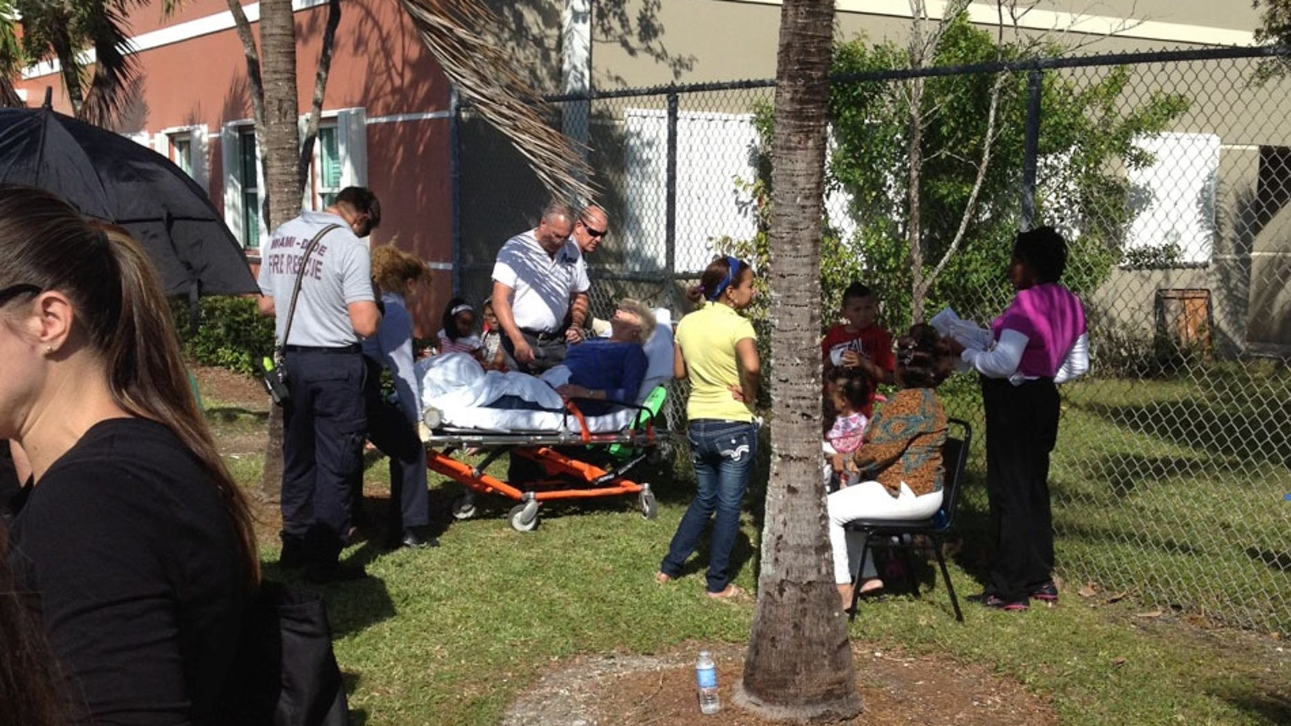 Tuesday, Nov. 6, 2012: A voter in the south Miami area appears to need medical assistance after waiting in 80-degree temperatures to vote.