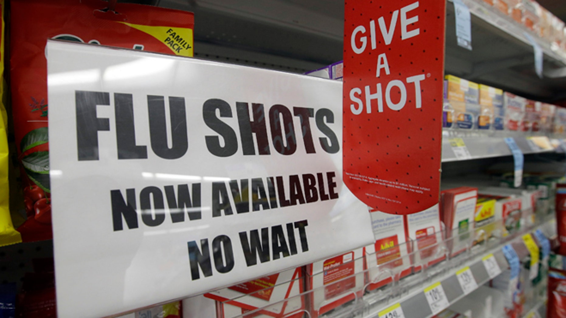 A sign telling customers that they can get a flu shot in a Walgreen store is seen Tuesday, Sept. 16, 2014, in Indianapolis. The nations biggest drugstores and retailers are grabbing larger chunks of the immunization market, giving customers more convenient options to protect themselves against the flu, pneumonia and more than a dozen other illnesses. (AP Photo/Darron Cummings)