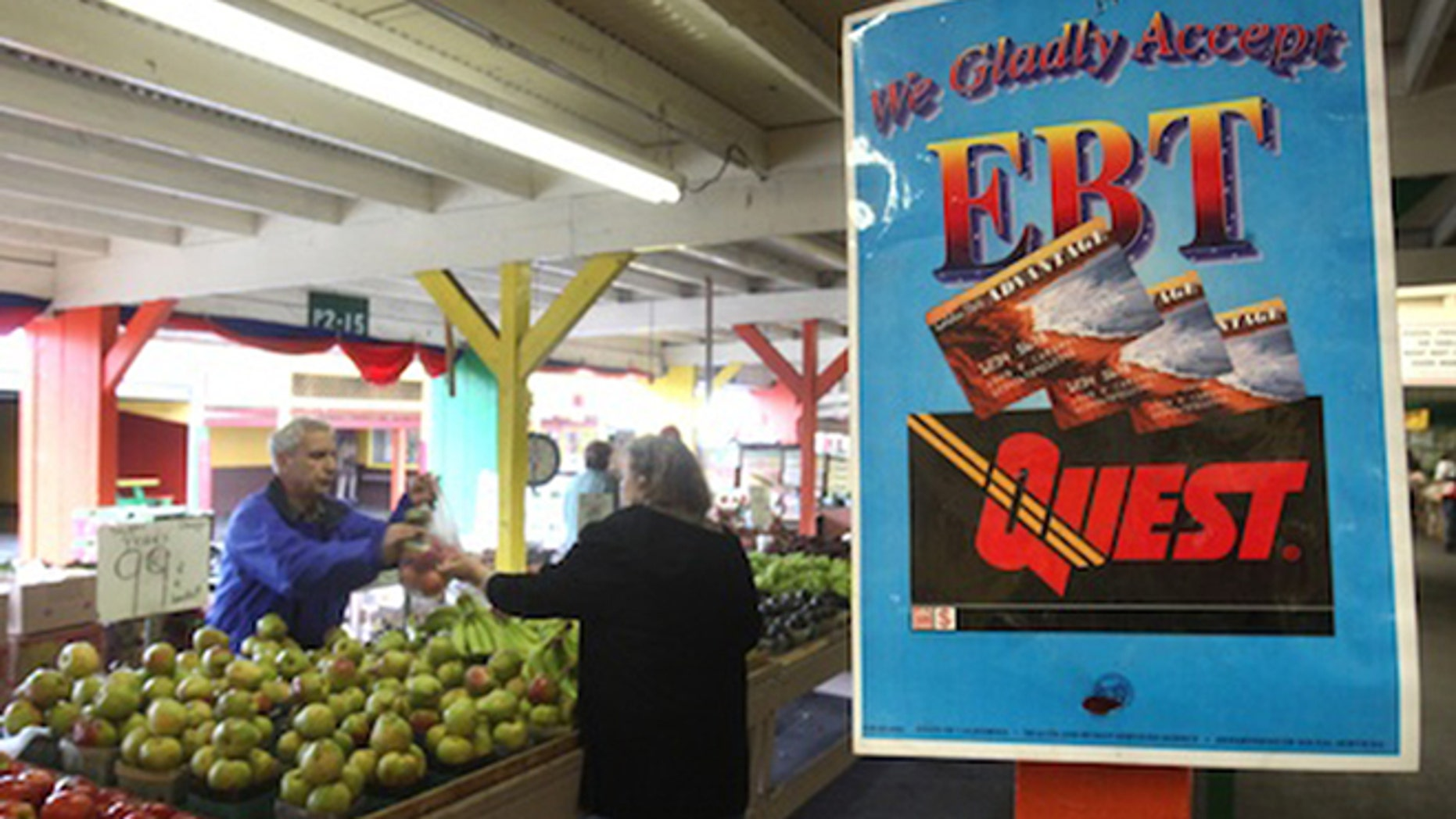 A sign announcing the acceptence of electronic Benefit Transfer cards is seen at the Denios Farmers market in Roseville, Calif.,   (AP Photo/Rich Pedroncelli)