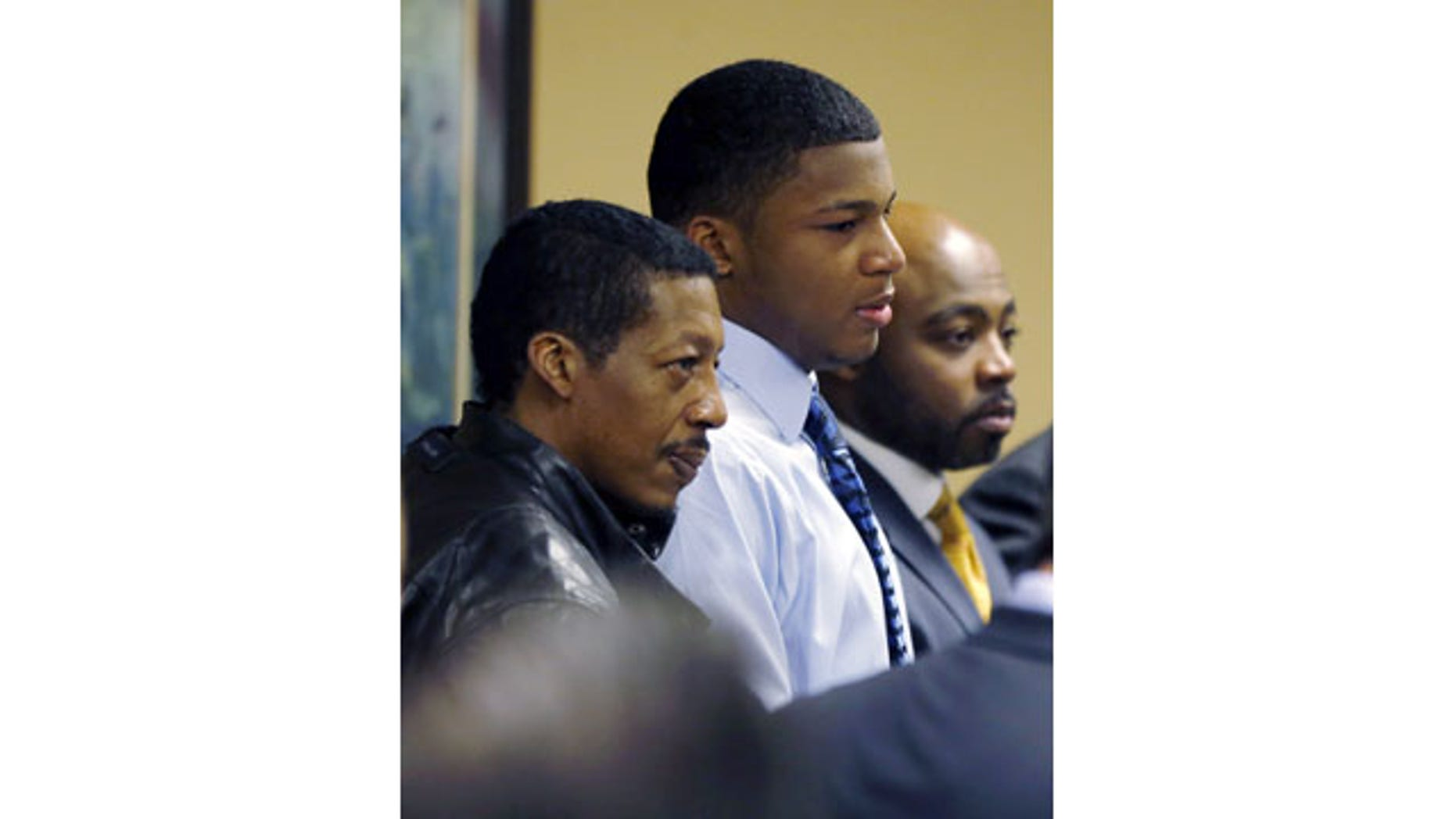 March 17, 2013: Ma'lik Richmond, center, stands with his father, Nathaniel Richmond, left, and attorney Walter Madison after he and co-defendant Trent Mays, 17, were found delinquent on rape and other charges in juvenile court in Steubenville, Ohio. (AP/File)