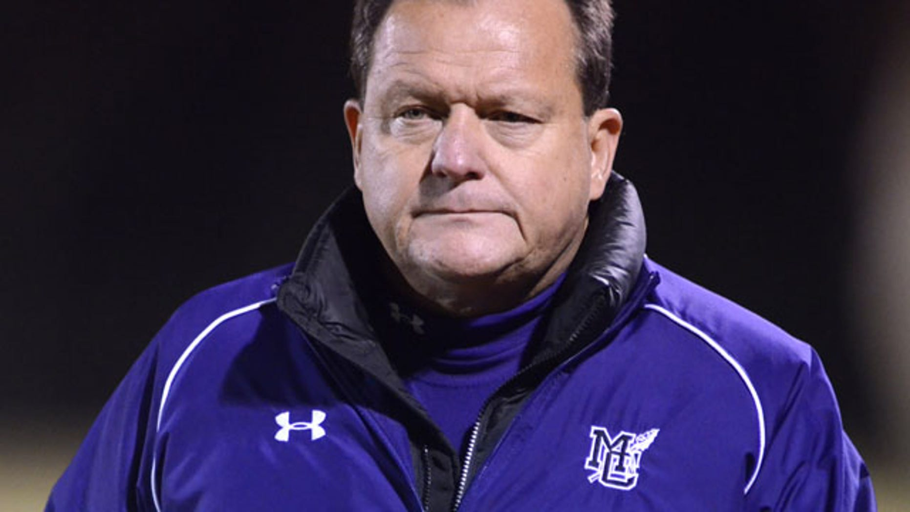 November 15, 2013: Marion County High School head coach Mac McCurry paces the sideline during a playoff football game in Chattanooga, Tenn. McCurry has resigned amid allegations that he and at least two of his assistants painted their team's field house with vulgarities and made it seem like the work of a rival high school. (AP Photo/Chattanooga Times Free Press, Robin Rudd)
