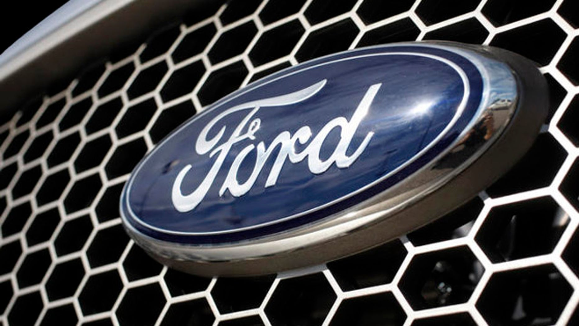 ** FILE ** In this Nov. 2, 2008 file photo, the blue oval logo of Ford Motor Company sits on the crosshatched grille of an unsold 2008 F-150 pickup truck at a Ford dealership in the southeast Denver suburb of Centennial, Colo. Ford Motor Co. on Monday, April 6, 2009 said it completed tender offers that will reduce its debt by 38 percent and shave millions of dollars off its interest costs.  (AP Photo/David Zalubowski, file)