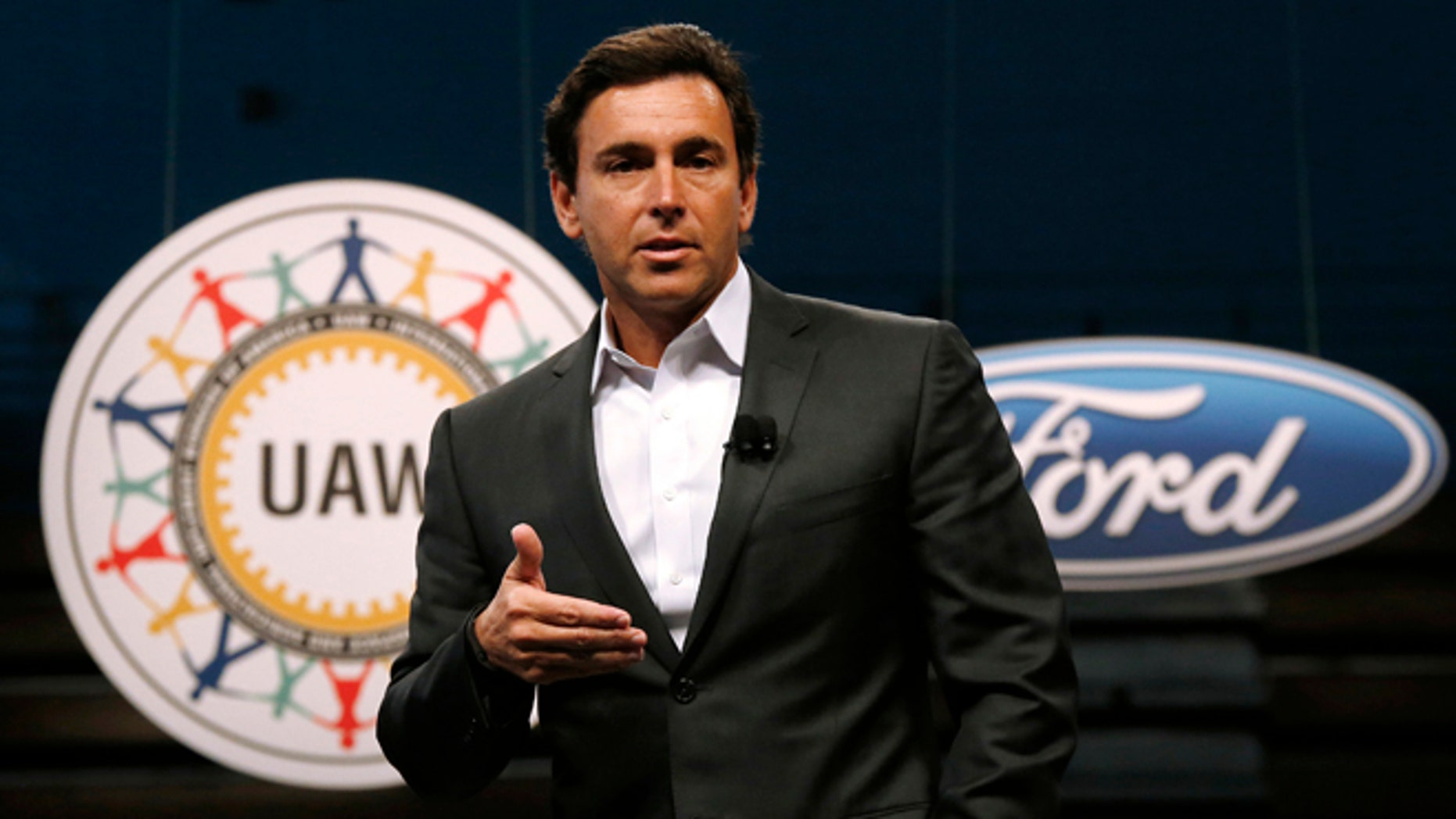 FILE - In this Thursday, July 23, 2015, file photo, Ford Motor Company President and CEO Mark Fields speaks during a ceremony to mark the opening of contract negotiations with the United Auto Workers in Detroit. (AP Photo/Paul Sancya, File)