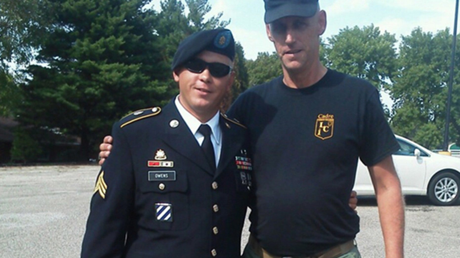 This undated family photo provided by Glen Welton shows U.S. Army Sgt. Tim Owens, left, of Effingham, Ill., with his cousin Glen Welton. Owens was one of three people killed by a shooter at Fort Hood, Texas on Wednesday, April 2, 2014. The shooter, identified as Ivan Lopez, also wounded 16 others before shooting himself, according to authorities. (AP Photo/Courtesy of the Owens family)