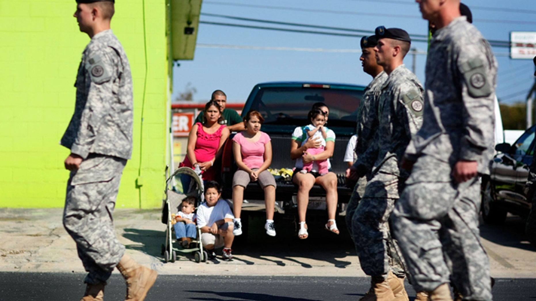 U.S. Army soldiers from Fort Hood march in a Veterans Day parade through downtown in Killeen, Texas.