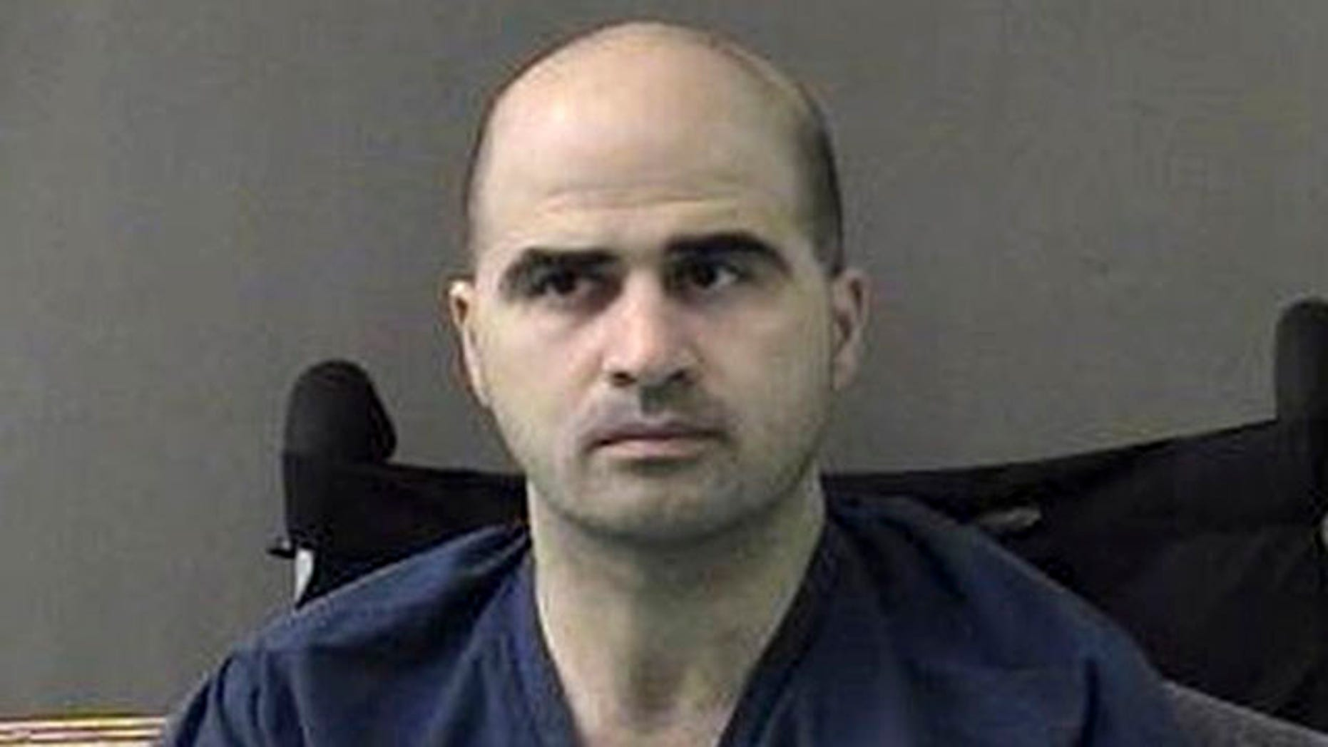 April 9, 2010: In a photo released by the Bell County Sheriffs Department, U.S. Major Nidal Hasan sits at the San Antonio to Bell County Jail in Belton, Texas.
