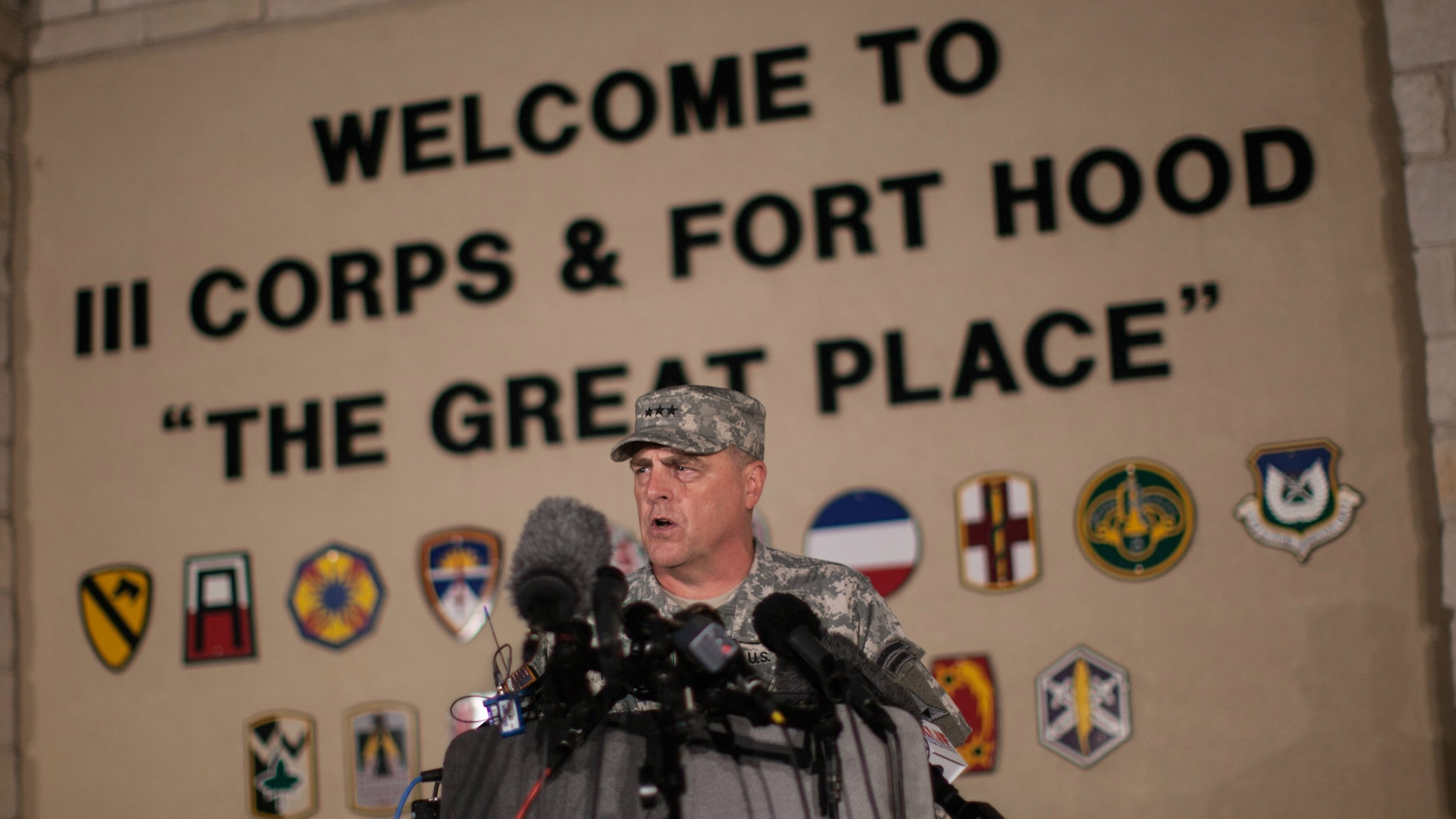 Lt. Gen. Mark Milley, commanding general of III Corps and Fort Hood, speaks with the media outside of an entrance to the Fort Hood military base following a shooting that occurred inside, Wednesday, April 2, 2014, in Fort Hood, Texas.