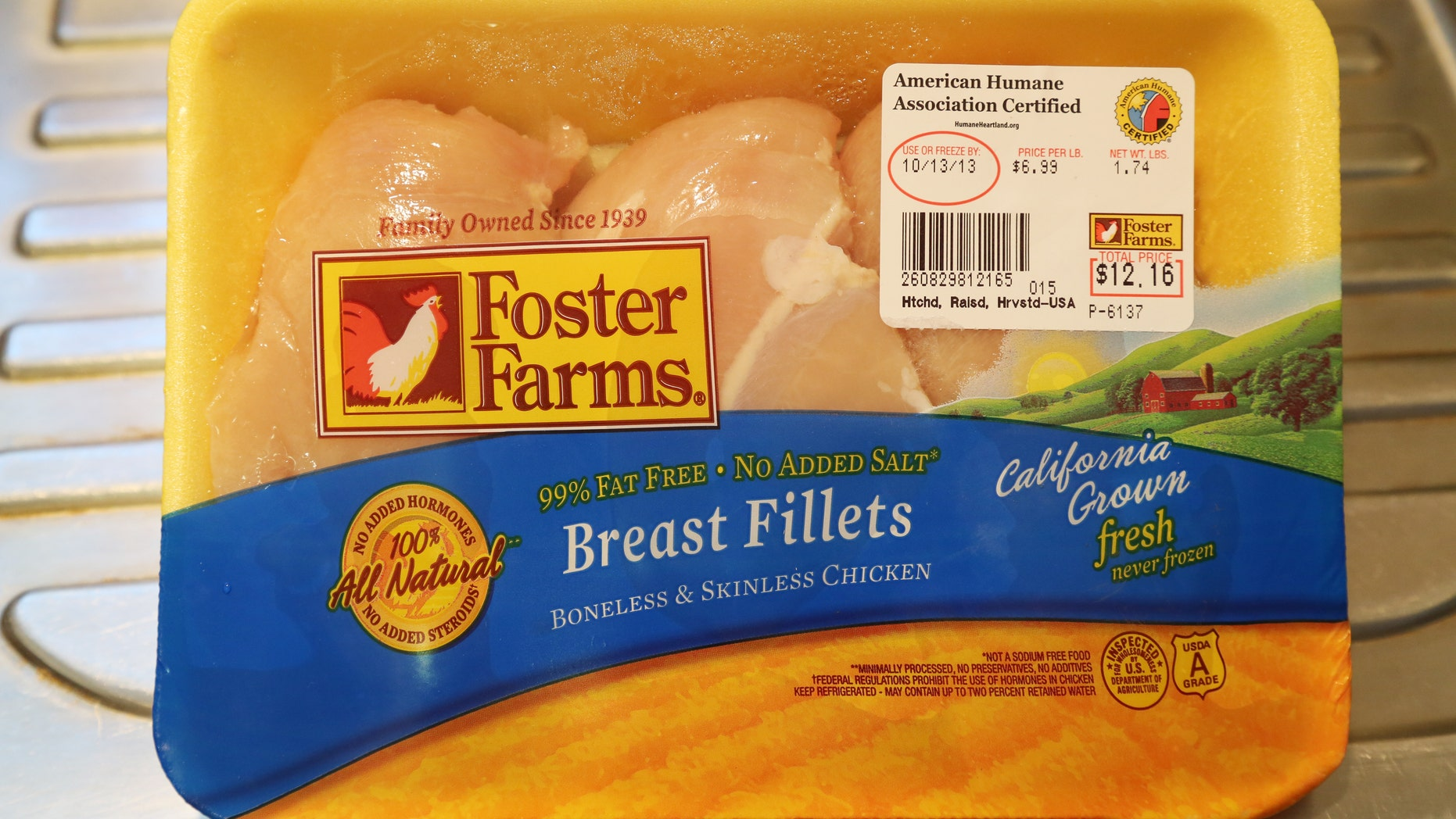 A package of Foster Farms fresh chicken fillets is pictured in this photograph taken in Burbank, California October 11, 2013. (REUTERS/Fred Prouser)