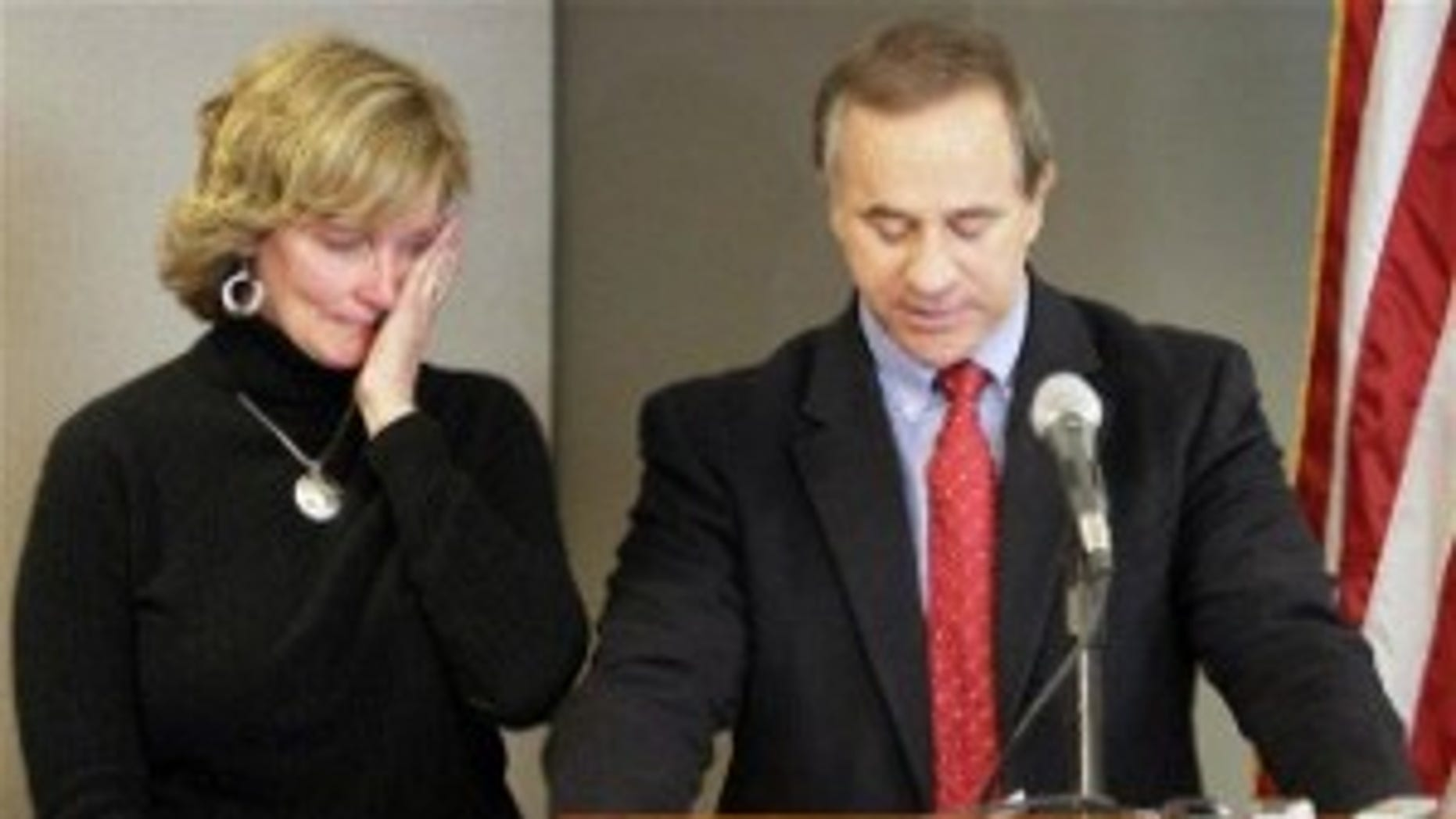 Rep. Steve Buyer (R-IN), right, announces he will not seek re-election because his wife, Joni, left, is ill during a news conference in Indianapolis. (AP Photo)
