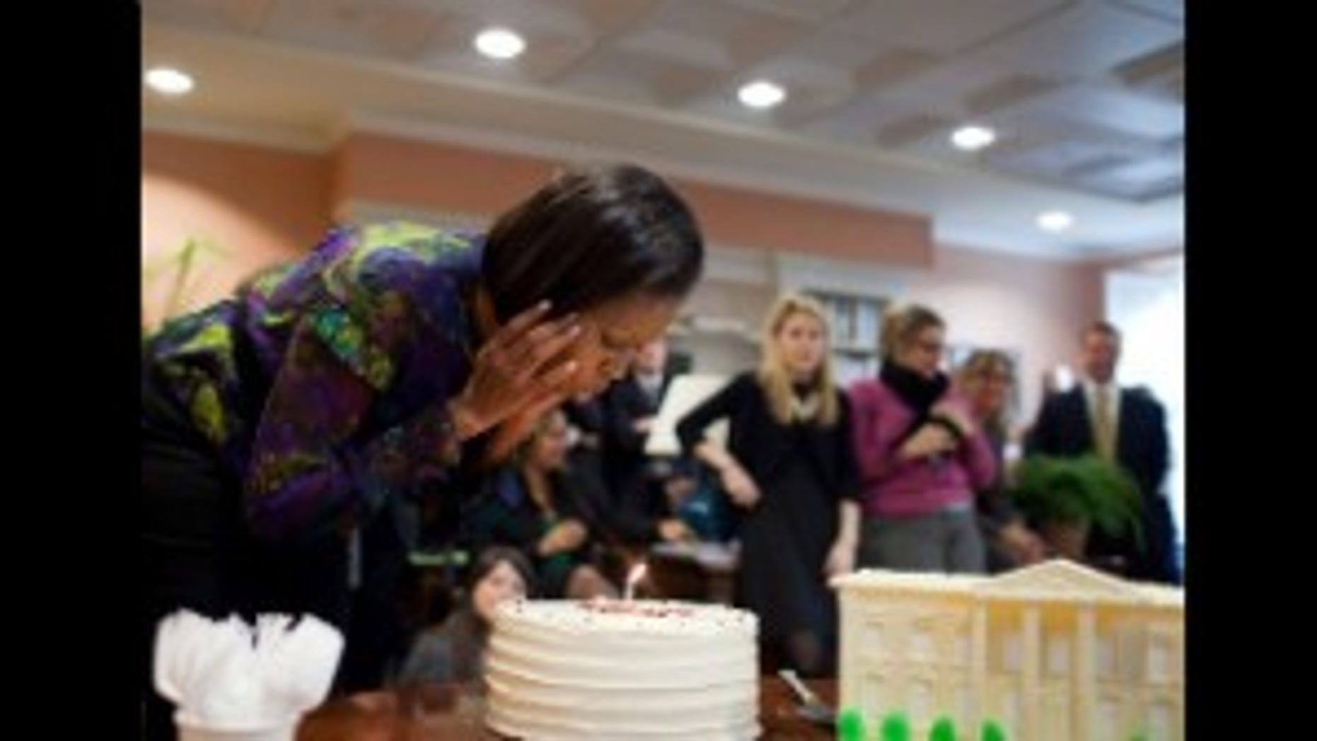 First Lady Michelle Obama has an early birthday celebration with her staff in the East Wing of the White House on Friday, Jan 15, 2010. (WH Photo)