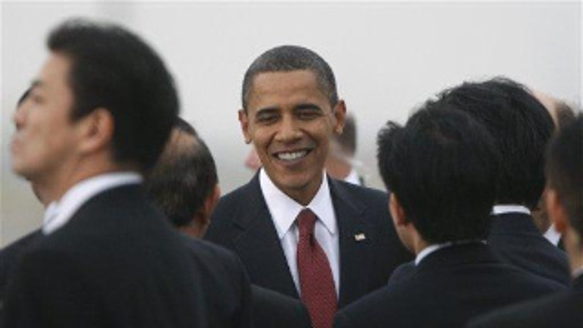 President Obama is greeted at Haneda Airport in Tokyo. (AP Photo)