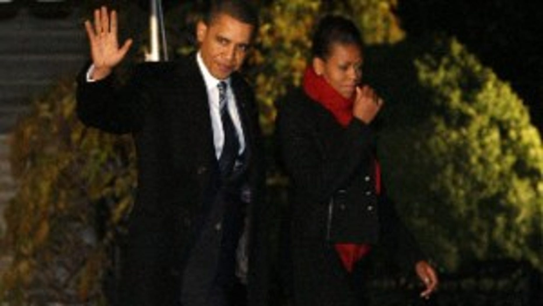 President Barack Obama and first lady Michelle Obama depart the White House in Washington, Wednesday, Dec. 9, 2009, en route to Oslo, Norway, where he will accept the Nobel Peace Prize. (AP Photo/Charles Dharapak)