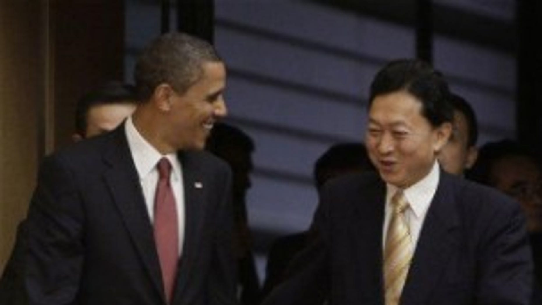 President Obama and Japanese PM Hatoyama walk together to their joint press conference (AP Photo)
