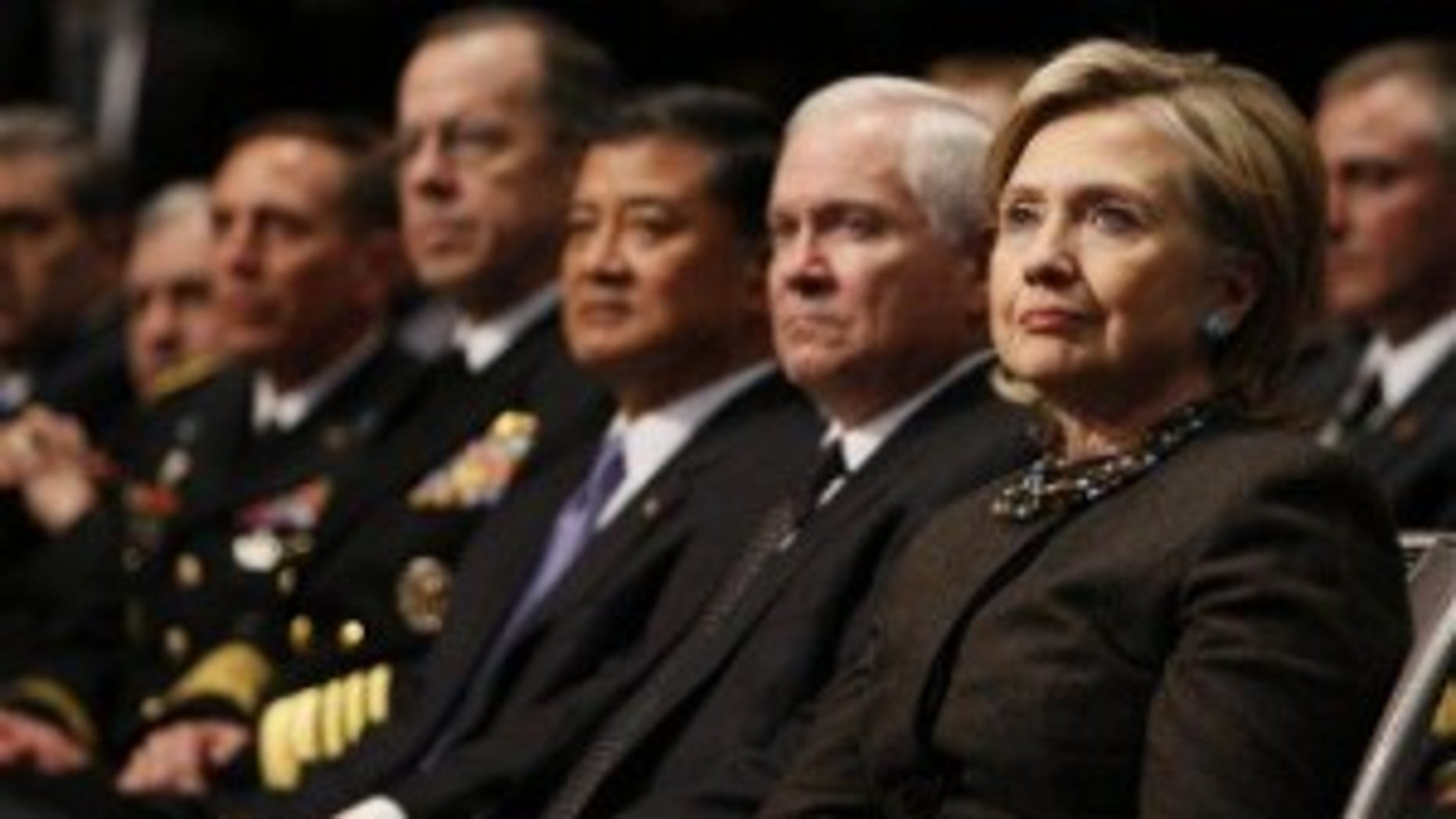 Secretary of State Hillary Clinton, right, and Defense Secretary Gates listen to President Obama's speech at U.S. Military Academy West Point (AP Photo)