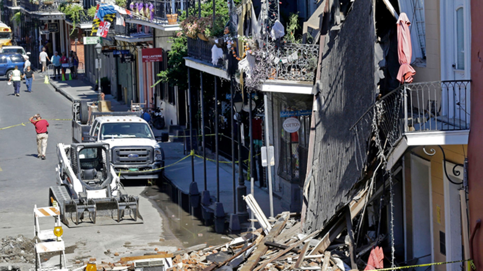 Oct. 22, 2014: In this photo, pedestrians walk by a three-story, brick-and-cypress building that collapsed in the historic French Quarter section of New Orleans. (AP)