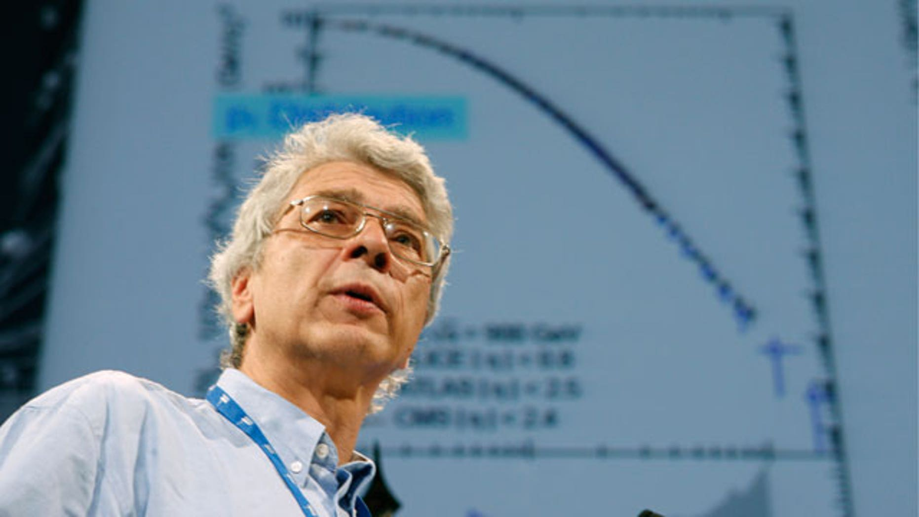 July 26: Dr. Juerg Schuknecht speaks to an audience of scientists during the 35th International Conference on High Energy Physics on the Alice experiment in Paris. International physicists announce today, some results from CERN, the European particle collider which aims at uncovering the secrets of the universe, and how the universe began. (AP)