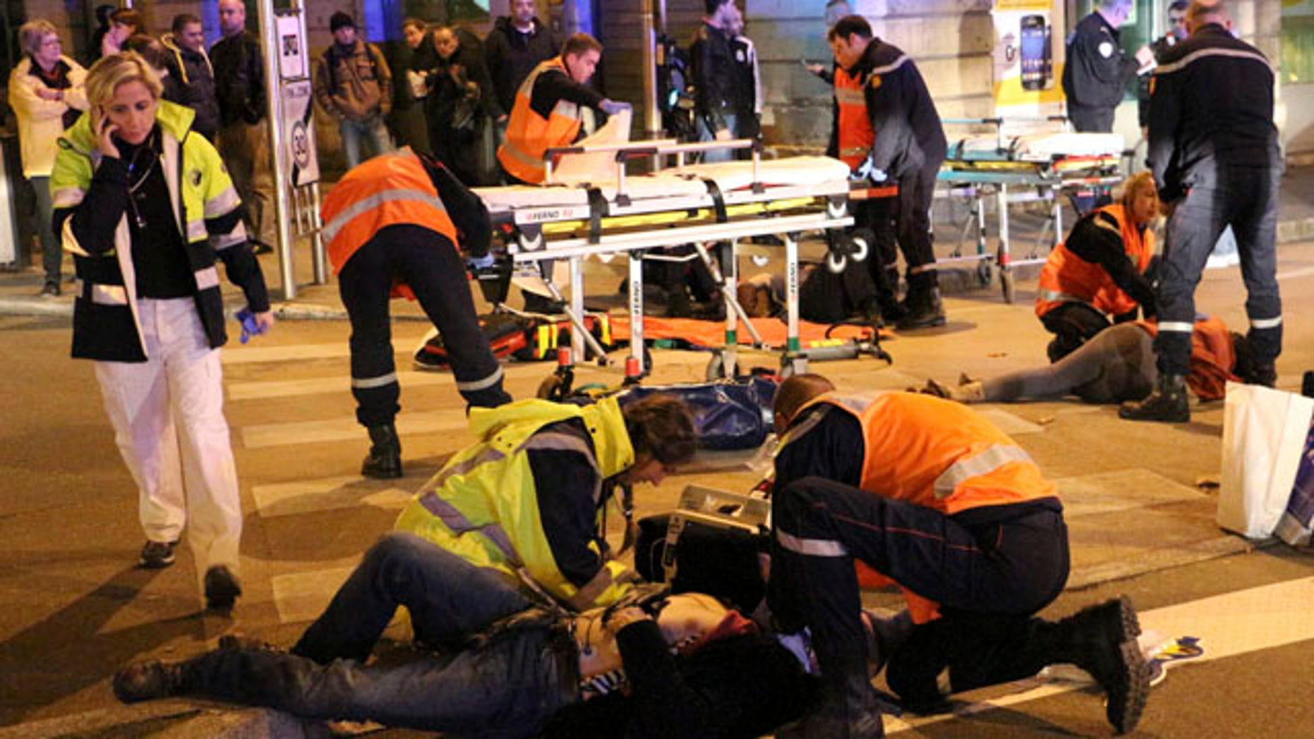 Dec. 21, 2014: This photo provided by local newspaper Le Bien Public shows rescue workers tending at victims after a driver deliberately slammed into passersby in several spots in Dijon, central France. (AP Photo/Christian Guileminot; Le Bien Public)