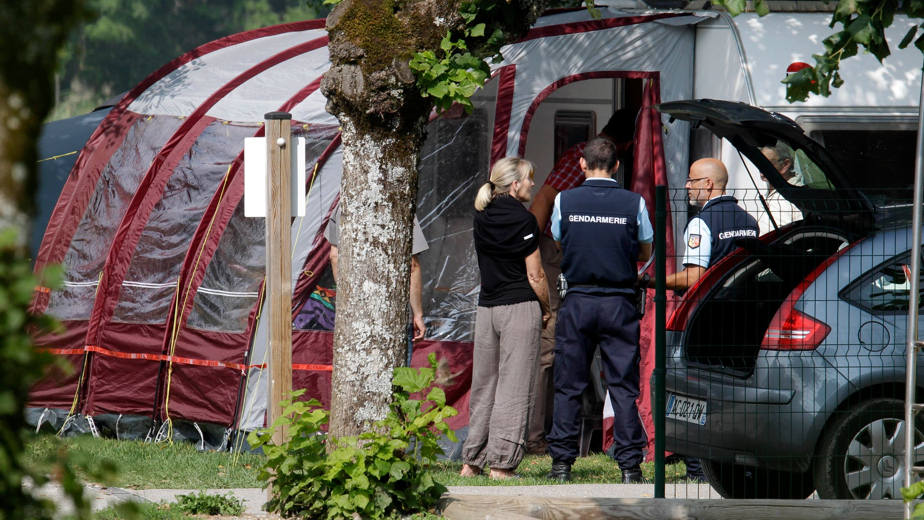Sept. 6, 2012 - Gendarmes and investigators stand at the camp site where the slain British family were holidaying in Saint Jorioz, near Annecy,  France.