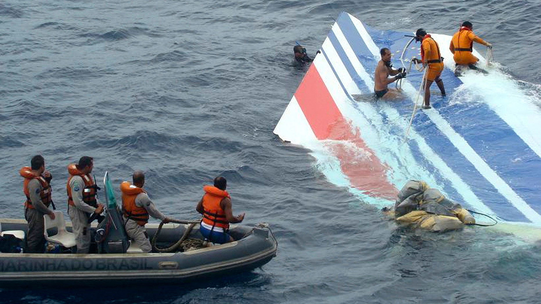 Brazil's Navy sailors recovering debris from the missing Air France jet at the Atlantic Ocean. Officials say flight recorders from an Air France plane that crashed nearly two years ago show that the captain only arrived in the cockpit after the plane had begun its fateful 3 1/2-minute descent. The initial findings of the French air accident investigation agency, the BEA, based on a reading of the so-called black boxes recovered from the ocean depths, found that the captain had been resting when the emergency began. All 228 aboard the Rio de Janeiro to Paris flight were killed on June 1, 2009.