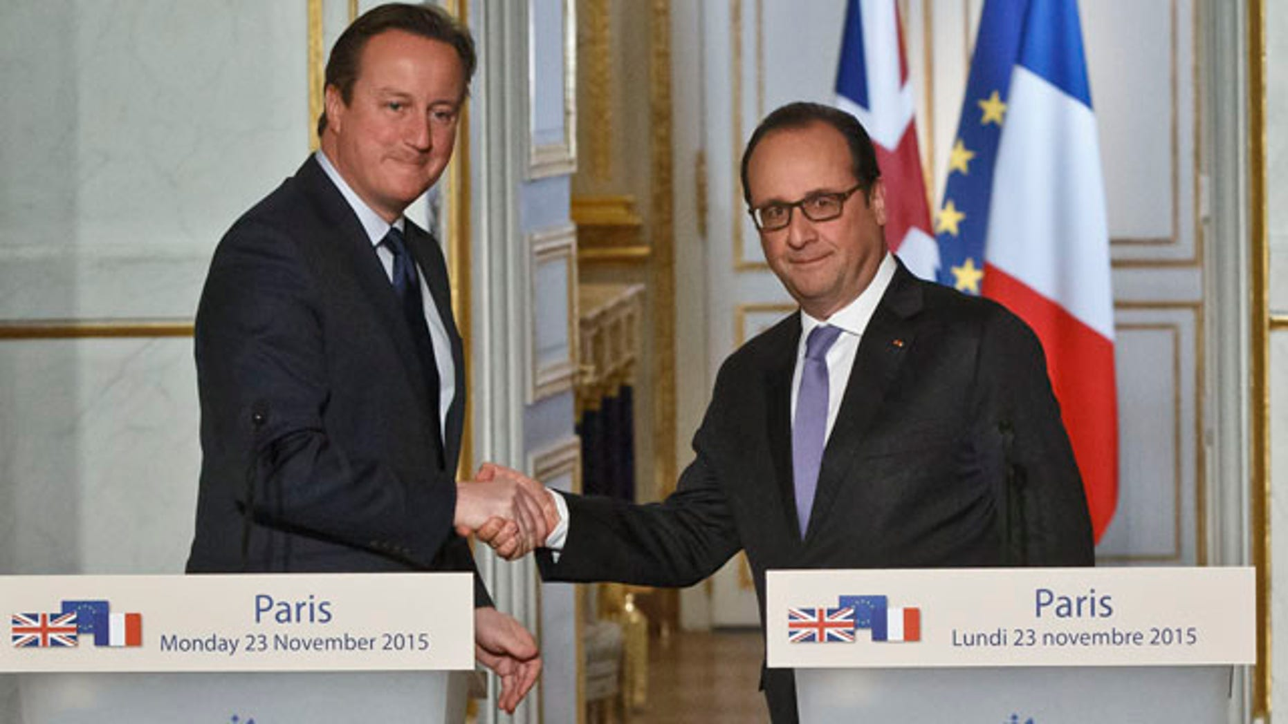 Nov. 23, 2015: Britain's Prime Minister David Cameron, left, and France's President Francois Hollande shake hands after they issued a joint statement to the media at the Elysee Palace in Paris. (AP Photo/Michel Euler)