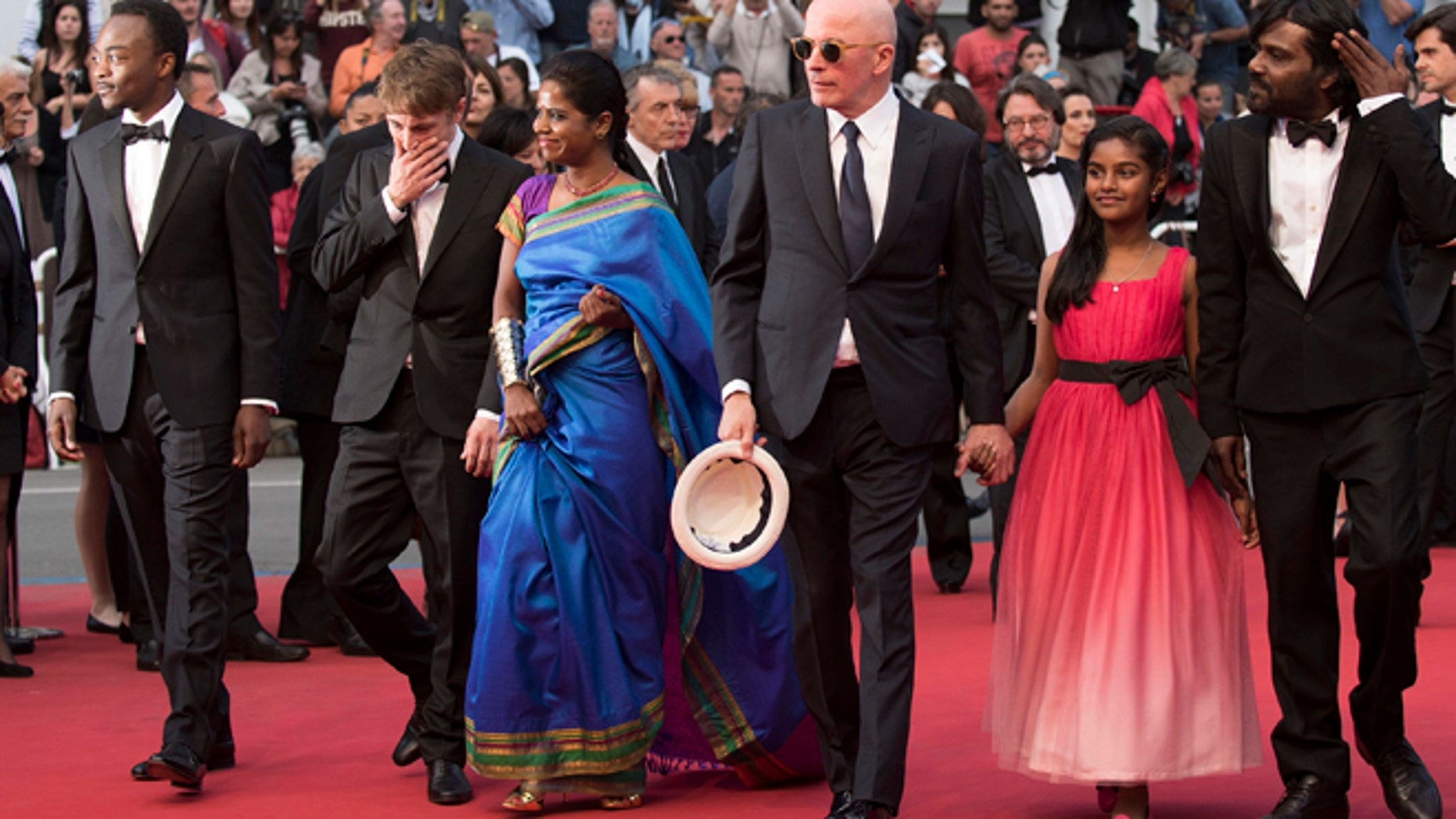 May 21, 2015: From left, Marc Zinga, Vincent Rottiers, Kalieaswari Srinivasan, director Jacques Audiard, Claudine Vinasithamby and Jesuthasan Antonythasan arrive for the screening of the film Dheepan at the 68th international film festival, Cannes, southern France.