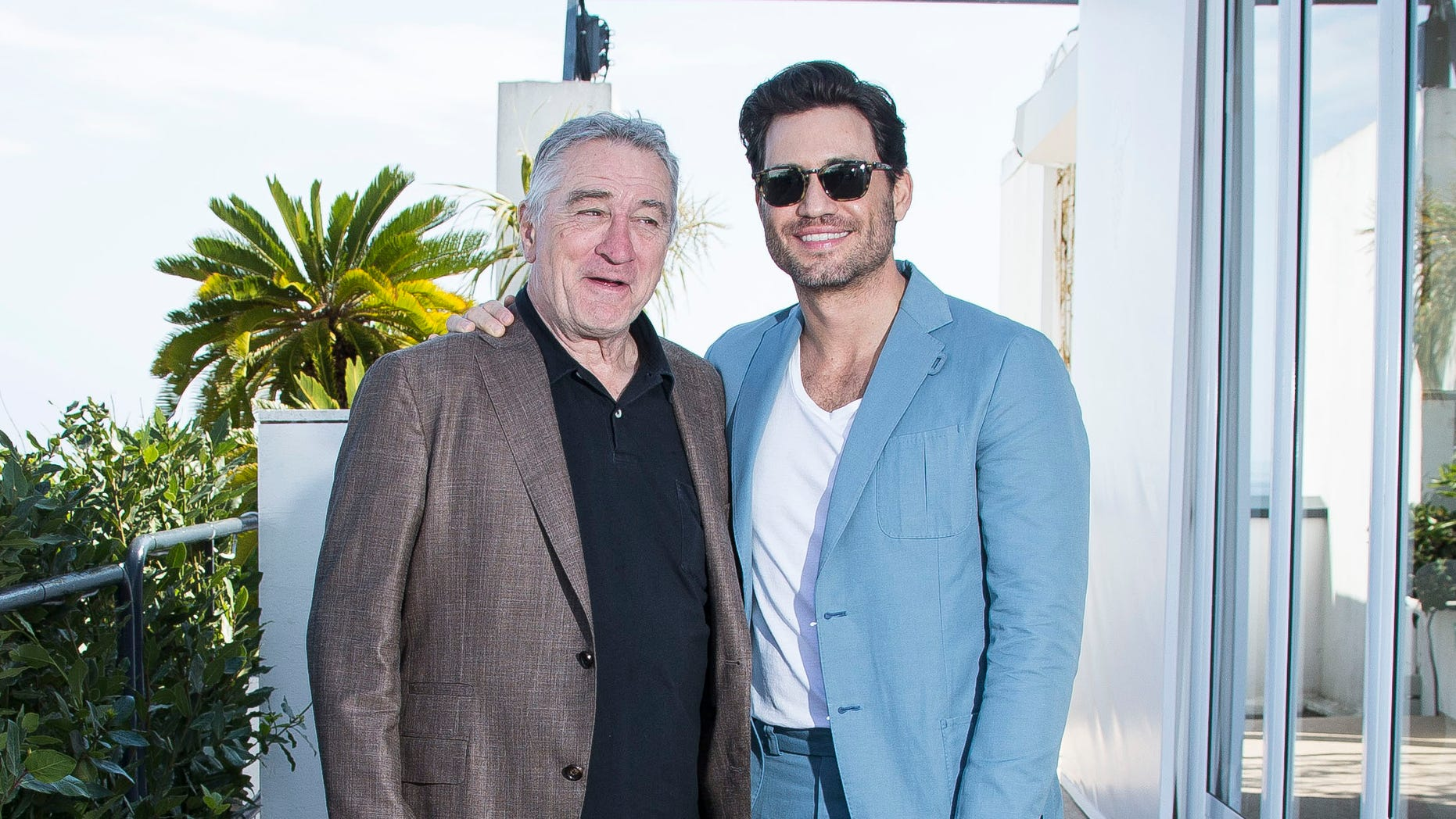 Actors Robert De Niro and Edgar Ramirez pose for portrait photographs for the film Hands of Stone at the 69th international film festival, Cannes, southern France, Tuesday, May 17, 2016. (AP Photo/Joel Ryan)