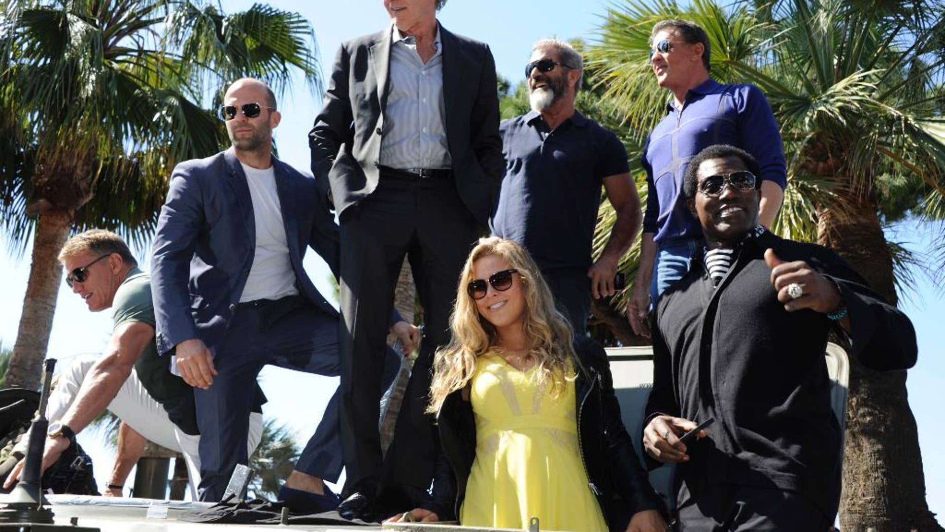 """From left, Dolph Lundgren, Jason Statham, Harrison Ford, Mel Gibson, Sylvester Stallone, Wesley Snipes and Ronda Rousey during a photo call for """"The Expendables 3"""" at the 67th international film festival, Cannes, southern France."""