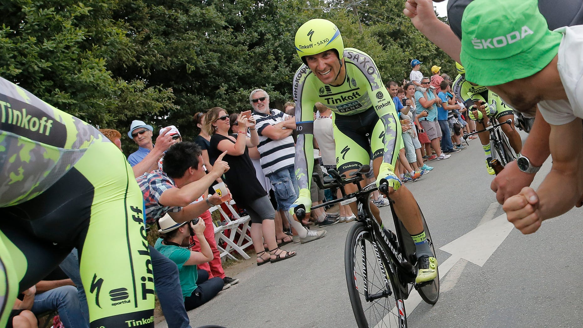 July 12, 2015 - Italy's Ivan Basso, left, trails behind his Tinkoff Saxo team with Spain's Alberto Contador, right, during the ninth stage of the Tour de France cycling race. Basso announced he has cancer in his left testicle and is dropping out of the Tour de France.
