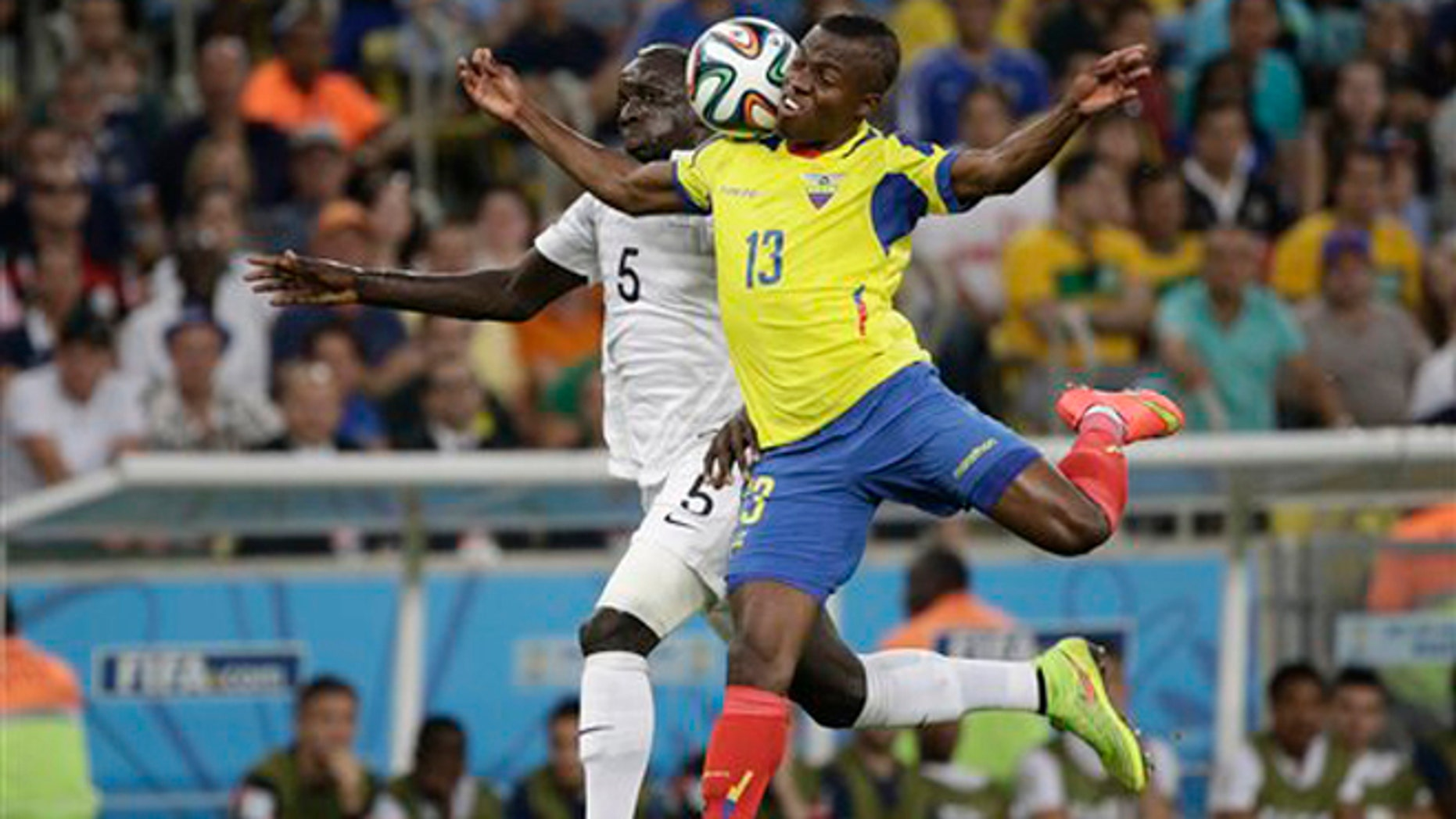 France's Mamadou Sakho, left, and Ecuador's Enner Valencia challenge for the ball during the group E World Cup soccer match between Ecuador and France at the Maracana Stadium in Rio de Janeiro, Brazil, Wednesday, June 25, 2014. (AP Photo/Christophe Ena)