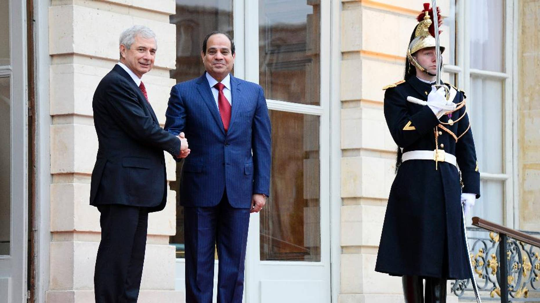 French National Assembly President Claude Bartolone, left, welcomes Egyptian President Abdel-Fattah el-Sissi  before their talks in Paris, France, Thursday Nov. 27 Nov. 2014. Sissi ends his two-day visit to France. (AP Photo/Bertrand Guay, Pool)