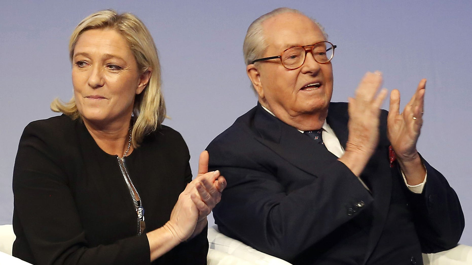 Saturday Nov. 29, 2014: French far-right Front National leader Marine Le Pen and her father Jean-Marie Le Pen applaud in Lyon, central France.