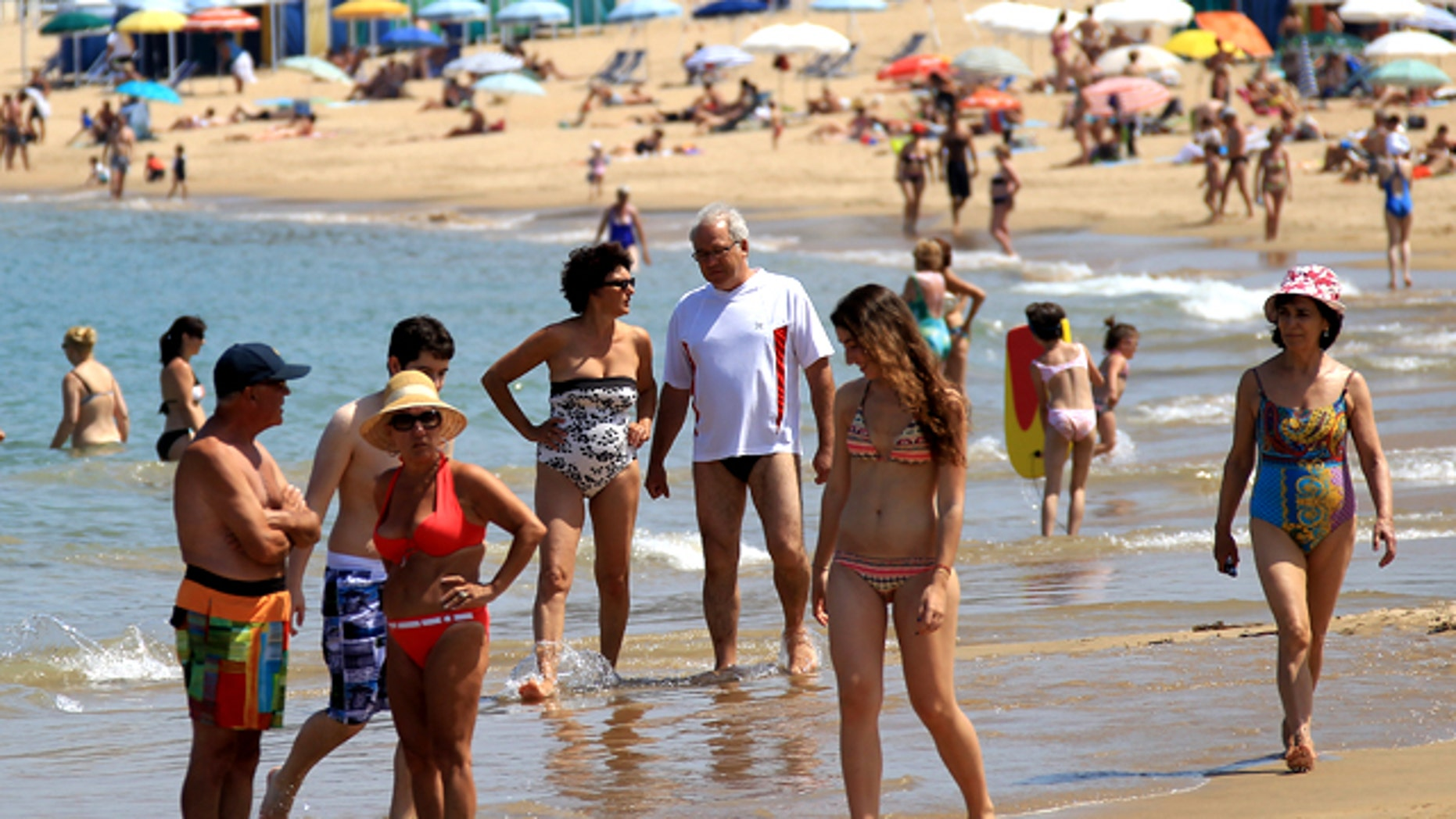 People refresh themselves at Saint Jean de Luz' beach, southwestern France, where the temperature rose to 38 degrees Celsius (100.4 degrees Fahrenheit) Monday, June 27, 2011.
