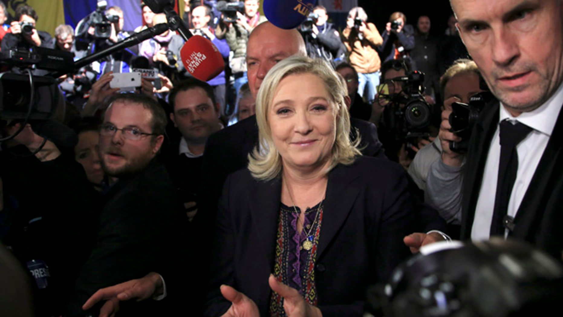 FILE - In this Dec.13, 2015 file photo, National Front party leader Marine Le Pen leaves after the results of the second round of the regional elections in Henin-Beaumont, northern France. (AP Photo/Thibault Camus, File)