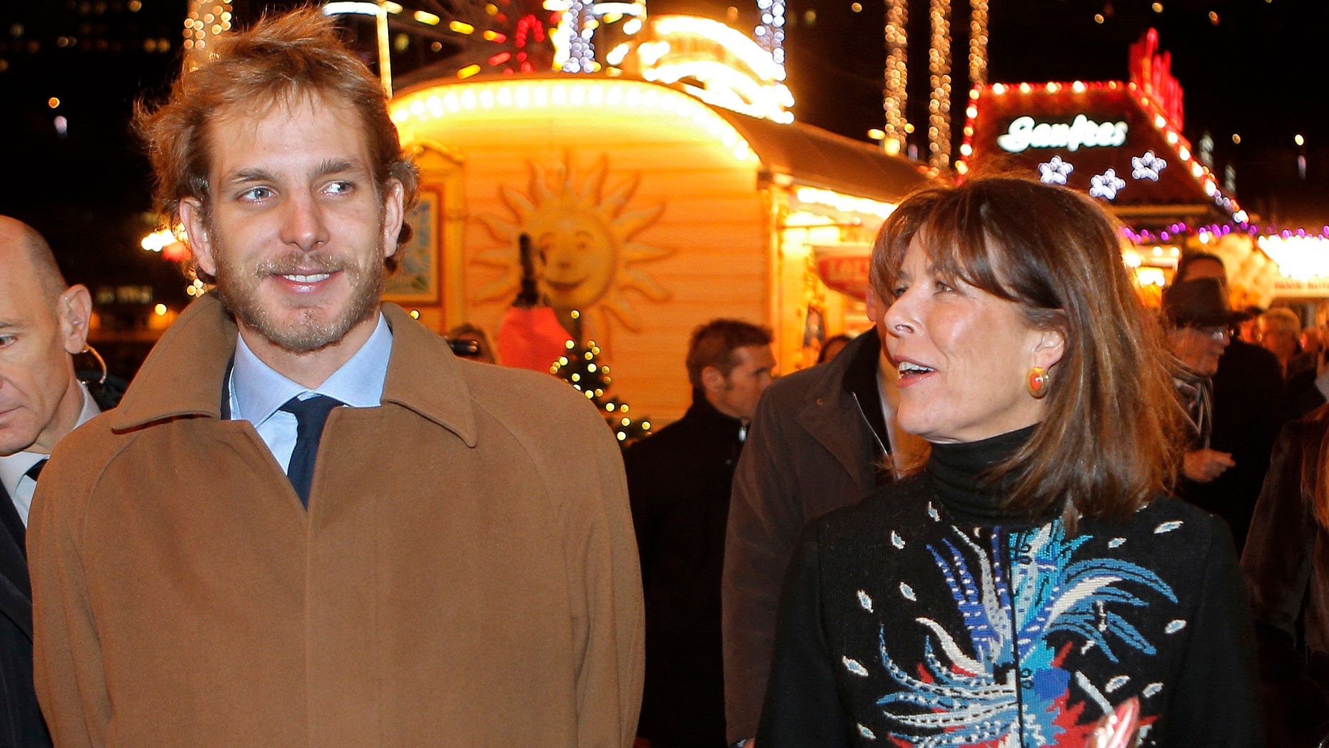 Princess Caroline of Hanover, right, and her eldest son Andrea Casiraghi,  attend the opening of the Christmas village in Monaco, in this file photo dated Wednesday, Dec. 5, 2012.  A baby boy is the latest addition to this jet set royal family, it is announced Friday March 22, 2013, born to Andrea Casiraghi and his Colombian fiancee heiress Tatiana Santo Domingo. Mother and child are understood to be in good health. (AP Photo/Lionel Cironneau, file)