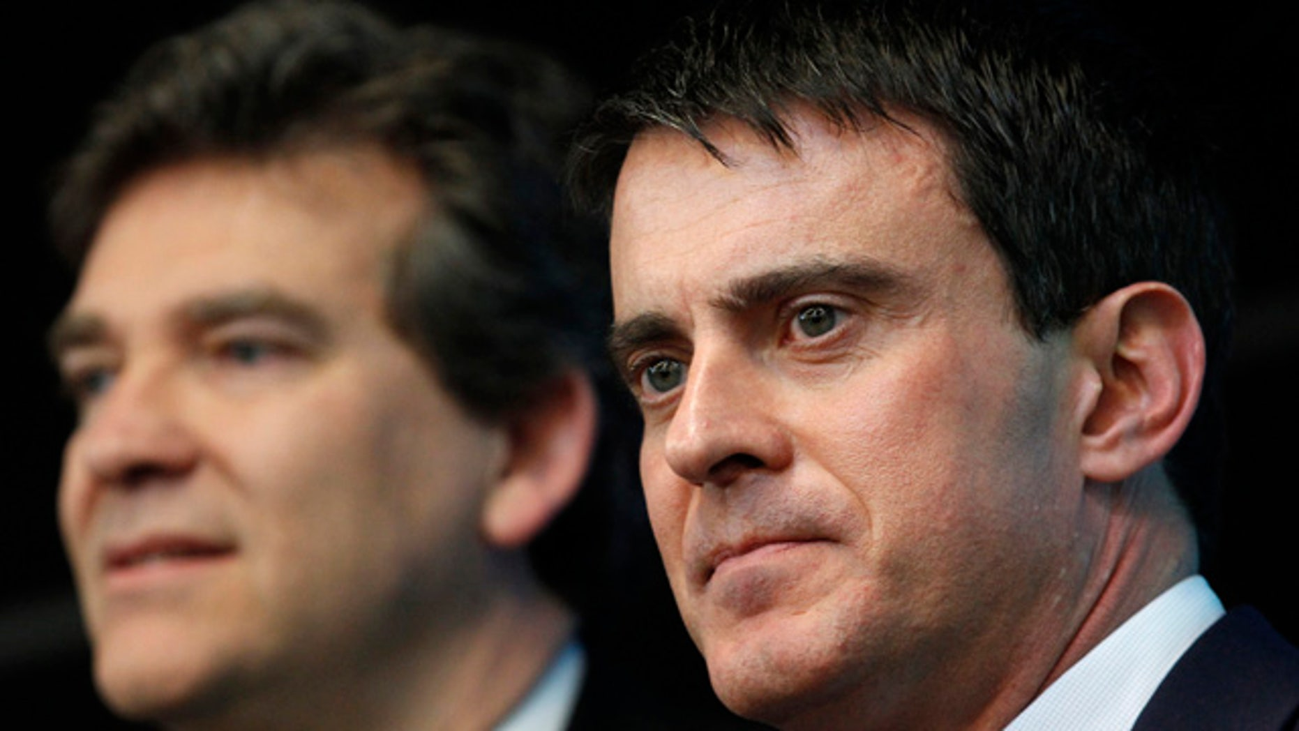 April 10, 2014: This photo shows French prime minister Manuel Valls, right, and Economy Minister Arnaud Montebourg during a visit to French defense and electronic company Thales in Gennevilliers, outside Paris. (AP)