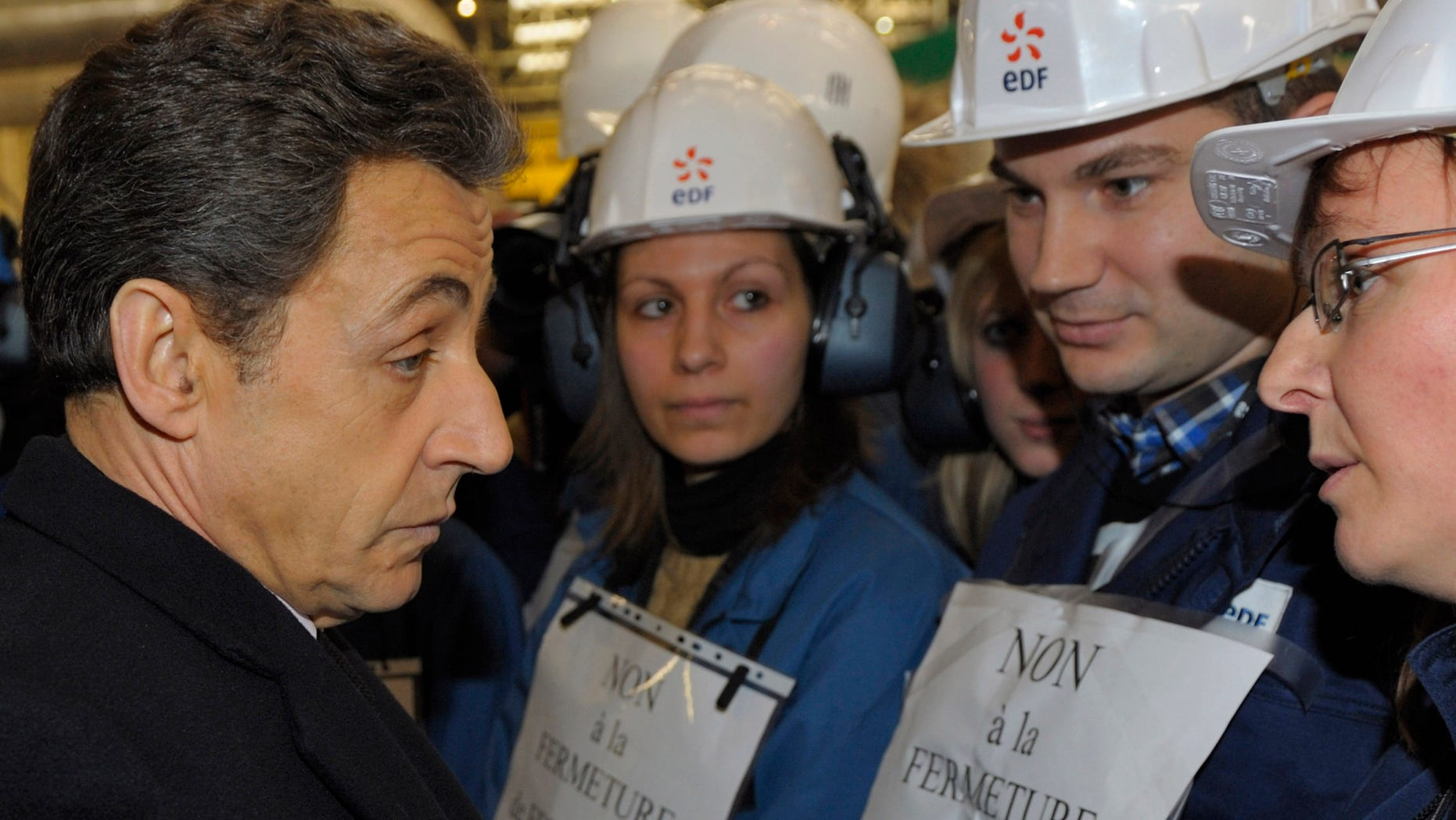 Feb. 9, 2012:France's President Nicolas Sarkozy, talks to workers at the nuclear power plant of Fessenheim, eastern France.