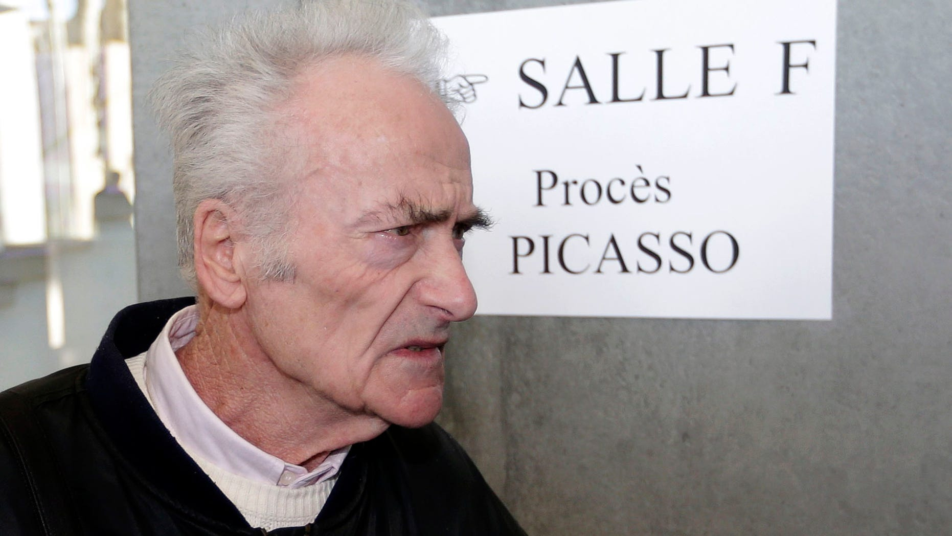 Pierre Le Guennec, 75, a retired electrician, arrives at Grasse criminal court, Tuesday, Feb. 10, 2015, in Grasse, southeastern France. Would Picasso have donated 271 works to an electrician who worked for him for a few years in southeast France? A French court began to contemplate that mystery on Tuesday at the start of a three-day trial of Pierre Le Guennec (Luh Gehn-EK) and his wife, Danielle. They claim that the artist, or his wife, gave them the 180 lithographs, collages and paintings and 91 drawings around 1970 when Le Guennec began working as a general handyman at Picasso's estate. (AP Photo/Lionel Cironneau)