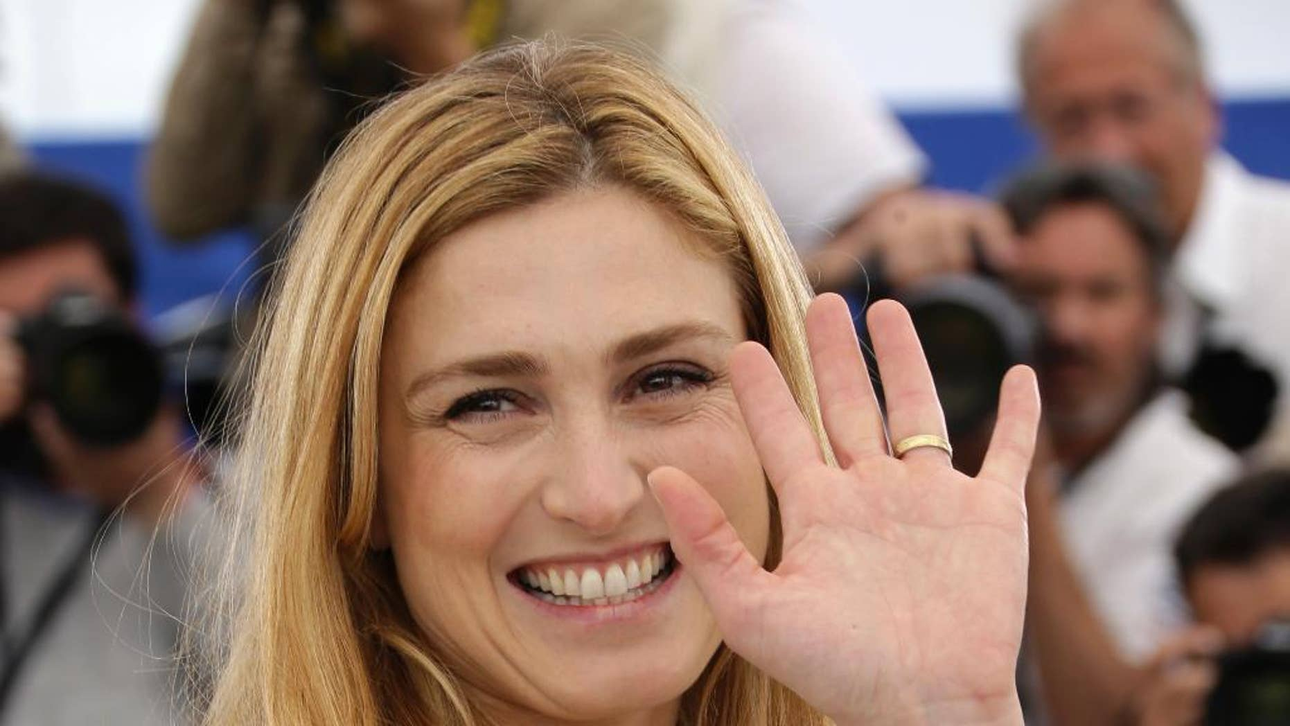 FILE - In this May 21, 2015 file photo, French actress and producer Julie Gayet poses for photographers during a photo call for the film Comoara (Treasure), at the 68th international film festival, Cannes, southern France. In her first appearance at an official ceremony in the presence of her partner President Francois Hollande, Gayet was invited Thursday June 18, 2015 to accompany her grandfather, Alain Gayet at a ceremony of commemoration of Charles de Gaulle's Appeal of June 18 at the Mont Valerien memorial west of Paris (Photo by Joel Ryan/Invision/AP, File)