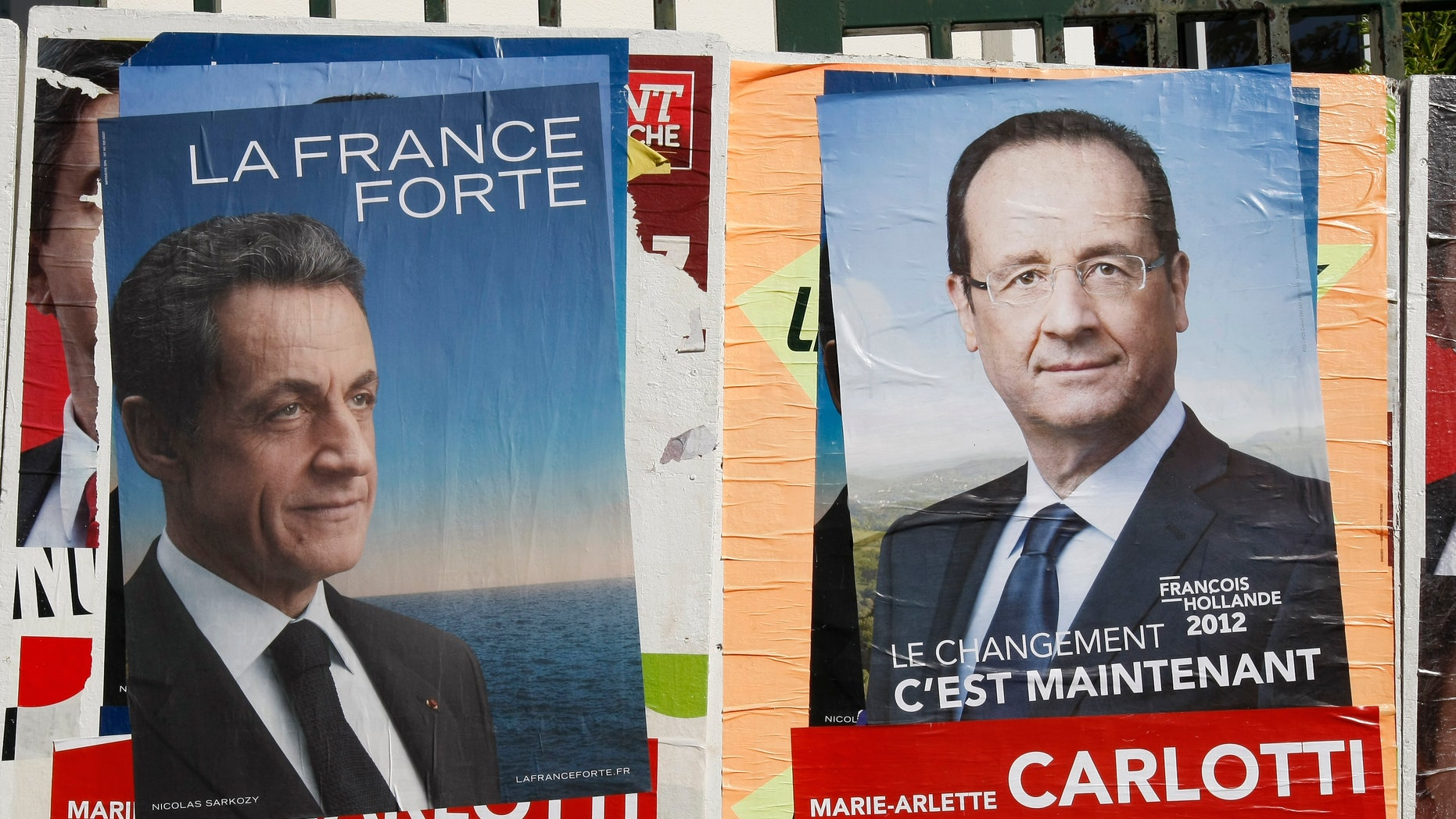 April 26, 2012: Posters of France's Socialist Party candidate Francois Hollande,  and France's President and candidate for re-election, in the 2012 French presidential election, Nicolas Sarkozy, are posted in front of a school, in Marseille, southern France.